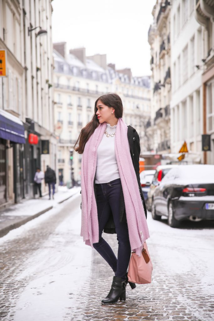 girl on the champs elysees paris longchamp le pliage pink free people lavender lilac winter scarf snow snowy street long straight brown hair hairstyle white ruffle turtleneck sweater top dark denim blue jeans shell seashell necklace france black booties