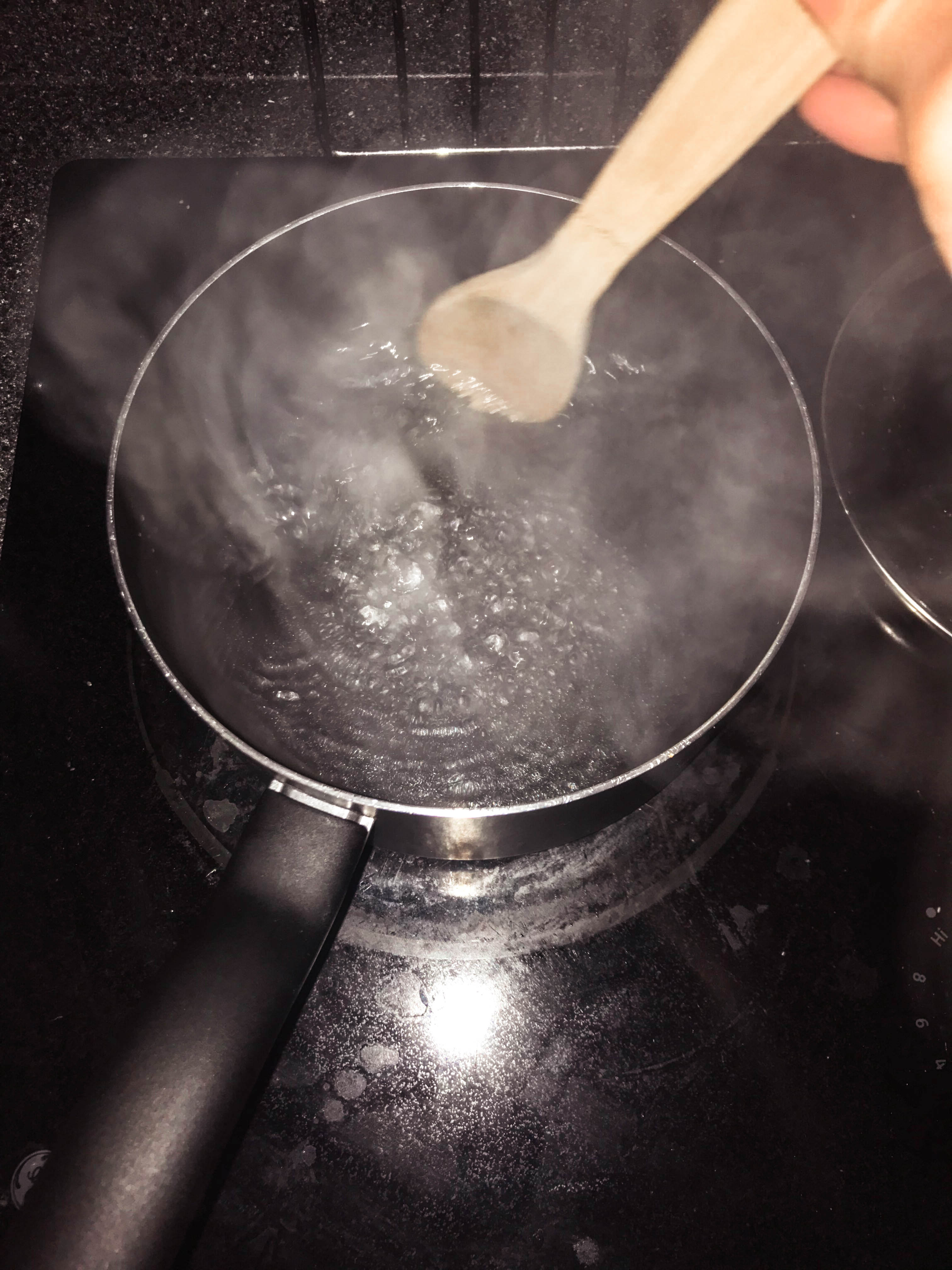 pot stove boiling water wooden spoon magic spoon cooking kitchen housework black steam DIY recipe