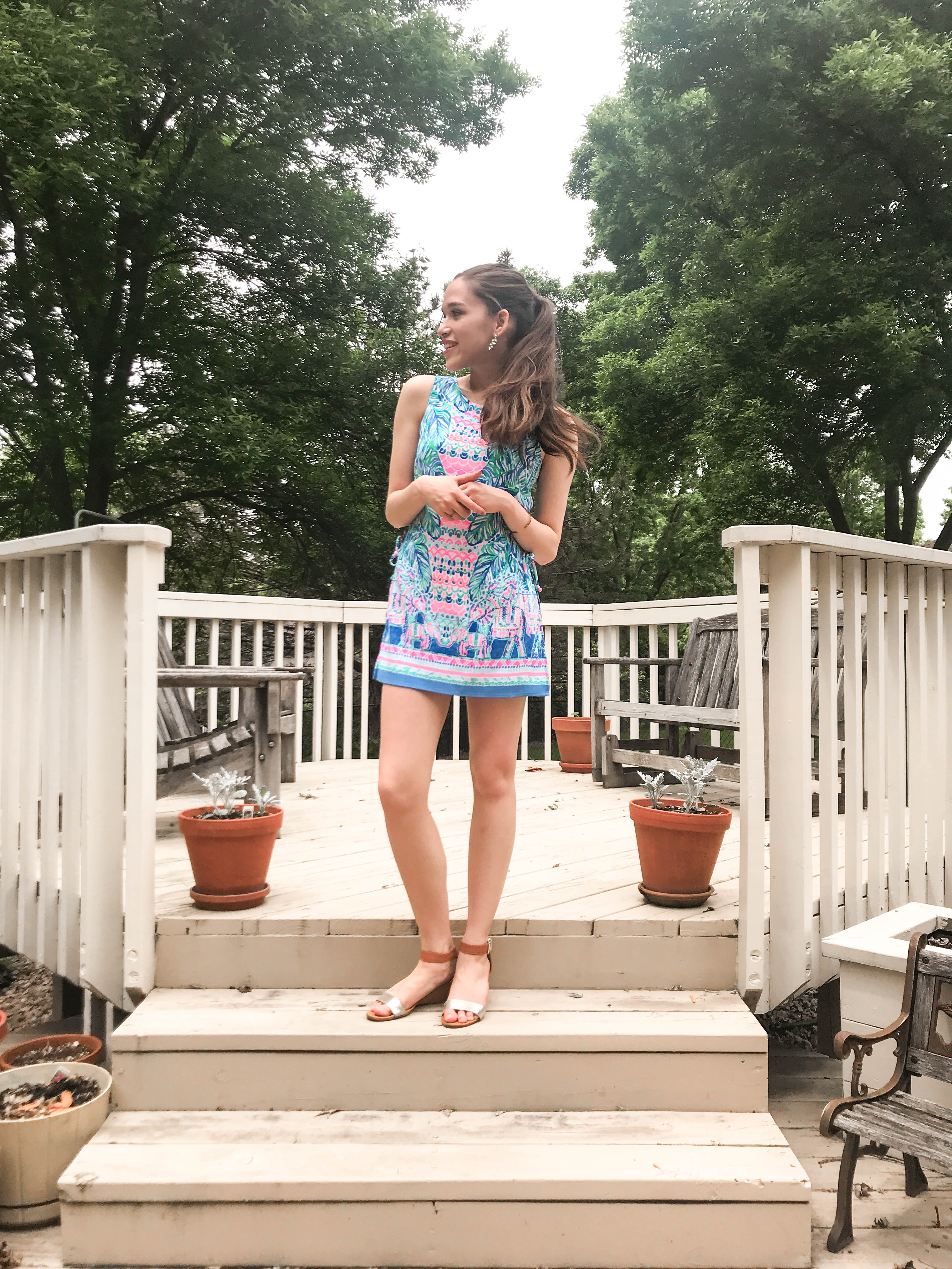 Lilly Pulitzer donna romper review feel the beat engineered preppy girl style womens outfit inspiratoin minnesota mn teen teenager girl with long straight brown hair in wrapped ponytail on white beige deck in the summer fashion gold wedge shoe shoes