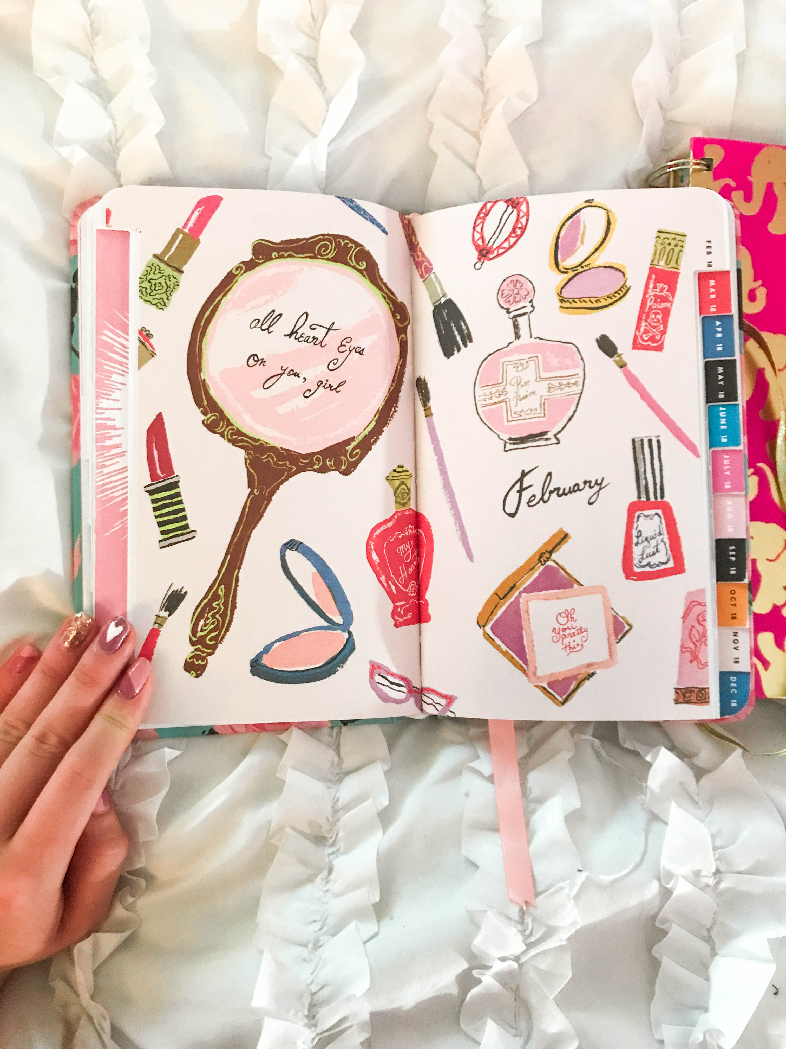 shop ban.do bando monthly month title page art mirror beauty compact lipstick mascara perfume hand in photo with heart manicure on white ruffle comforter