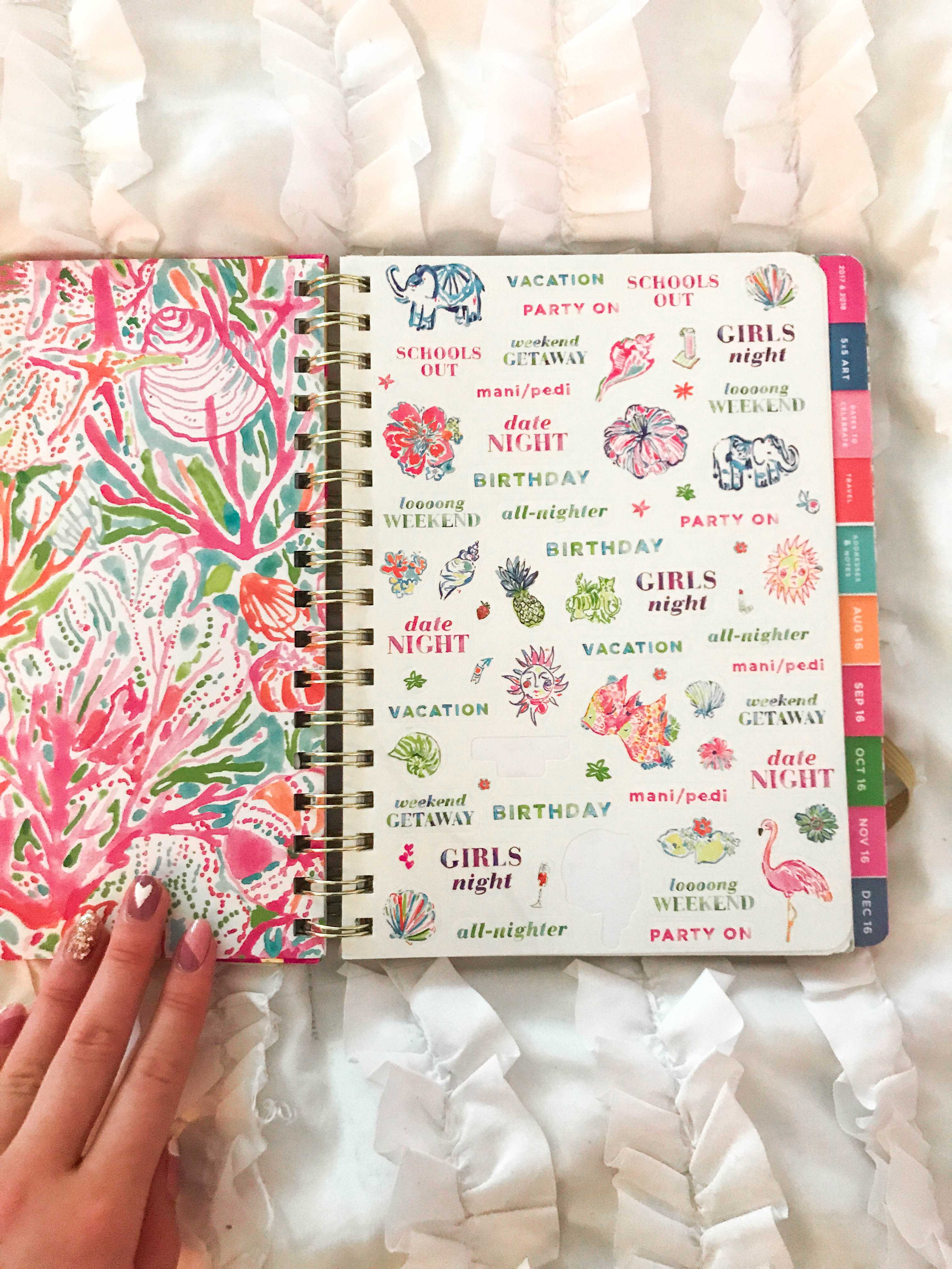 lilly pulitzer preppy agenda planner stickers organization stationary flatlay on white ruffle duvet comforter watercolor art floral flowers hand lettering