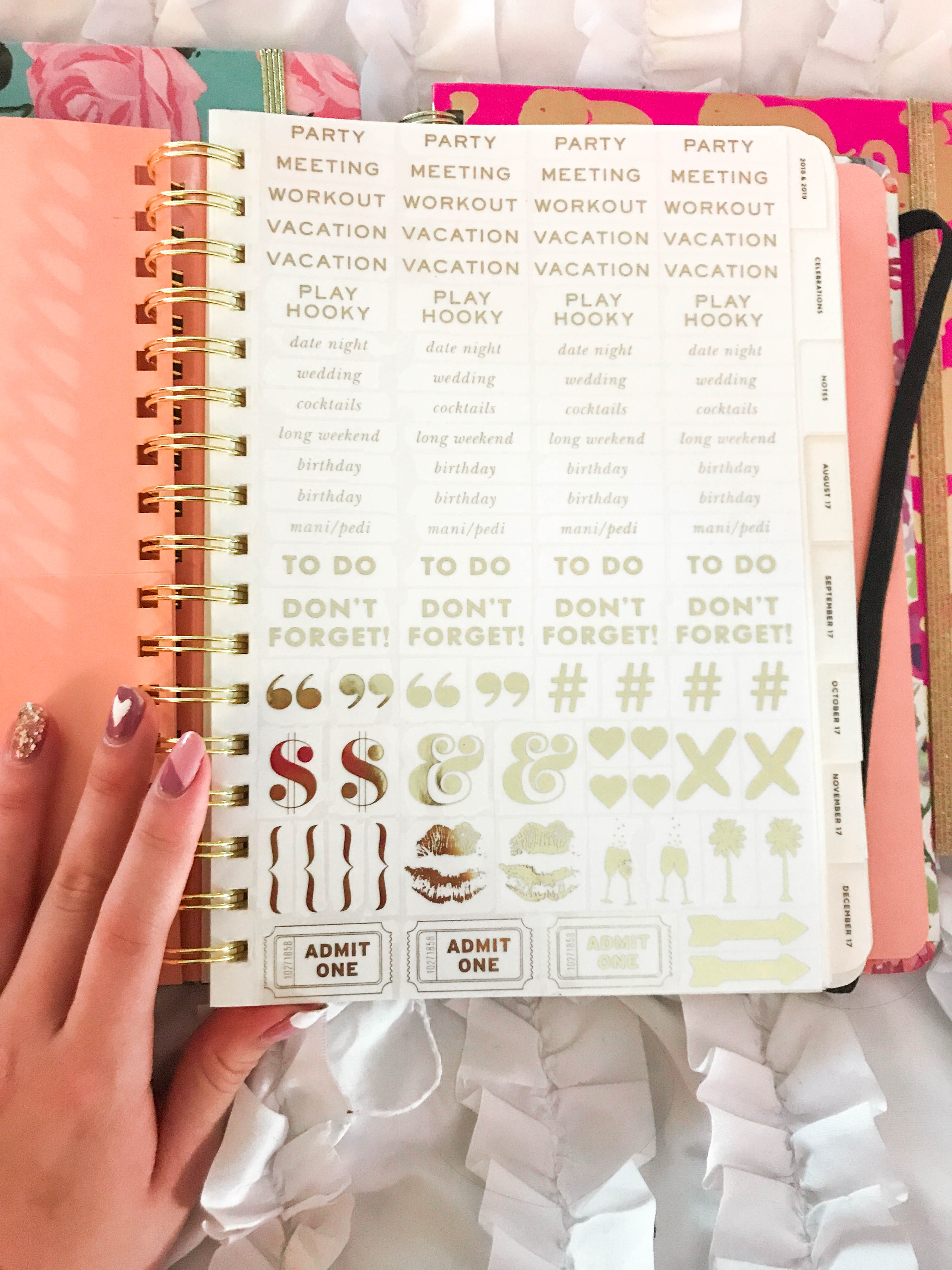 kate spade agenda planner gold metallic foil stickers on white ruffle duvet with heart manicure nail art organization stationary flatlay hand in photo