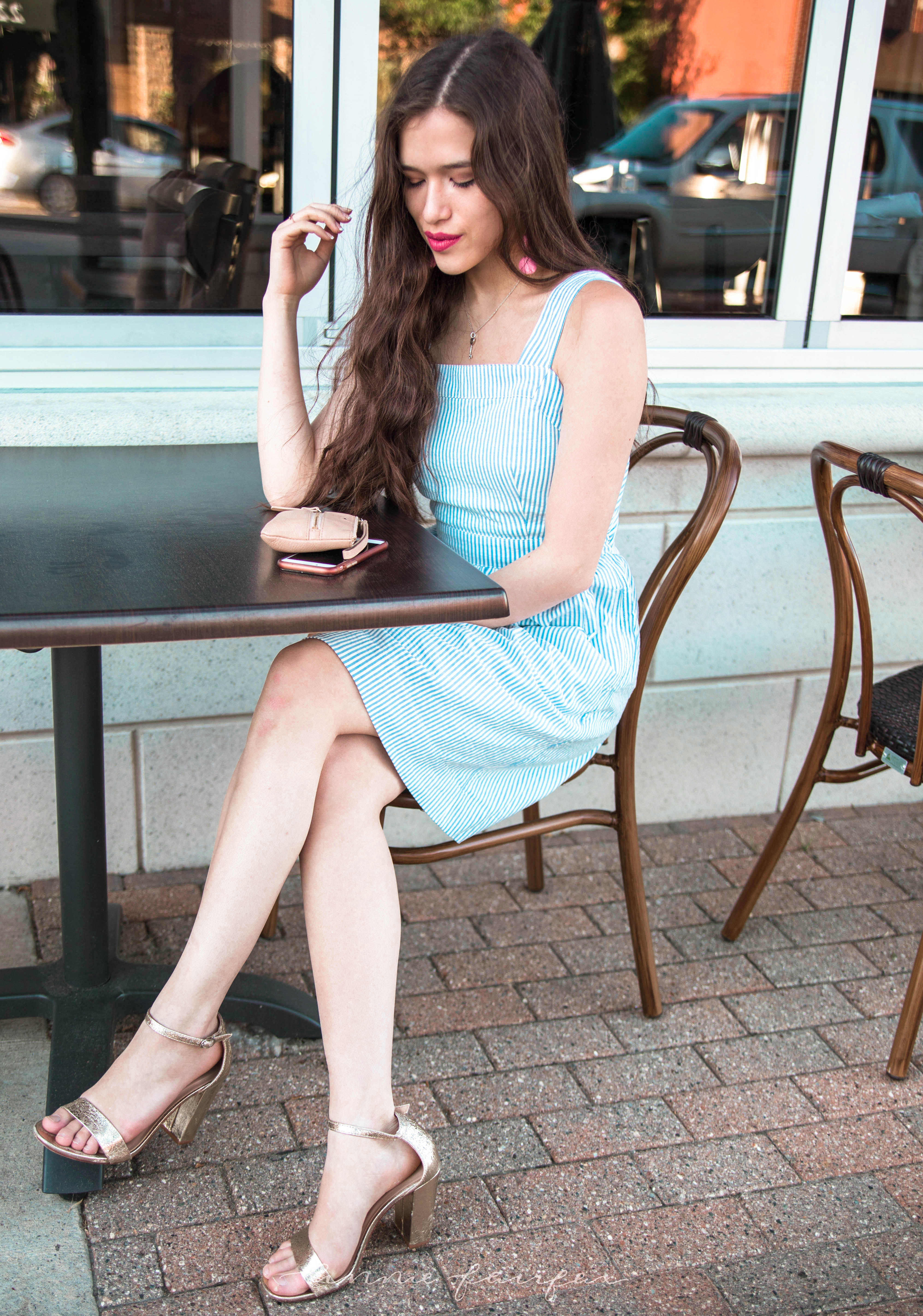 j. crew jcrew factory blue and white seersucker minidress fit and flare dress with pockets above the knee gold metallic chunky heels long brown wavy hair girl standing on sidewalk preppy style flattering for any body type sitting in chair at cafe looking at phone summer style inspiration warm weather clothing for teens women classic with a twist kate spade bee wristlet