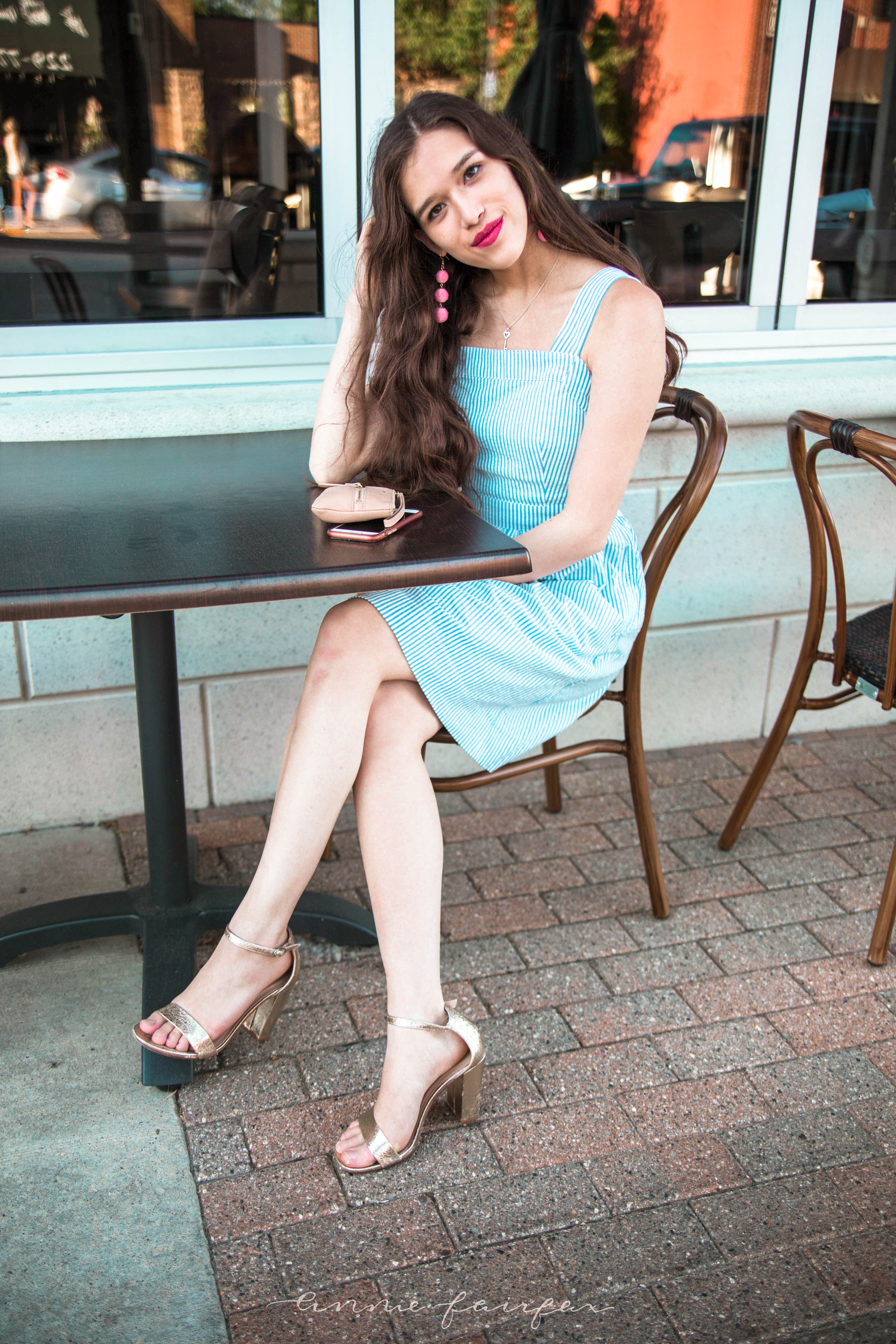j. crew jcrew factory blue and white seersucker minidress fit and flare dress with pockets above the knee gold metallic chunky heels long brown wavy hair girl standing on sidewalk preppy style flattering for any body type sitting in chair at cafe  with phone summer style inspiration warm weather clothing for teens women classic with a twist kate spade bee wristlet target style