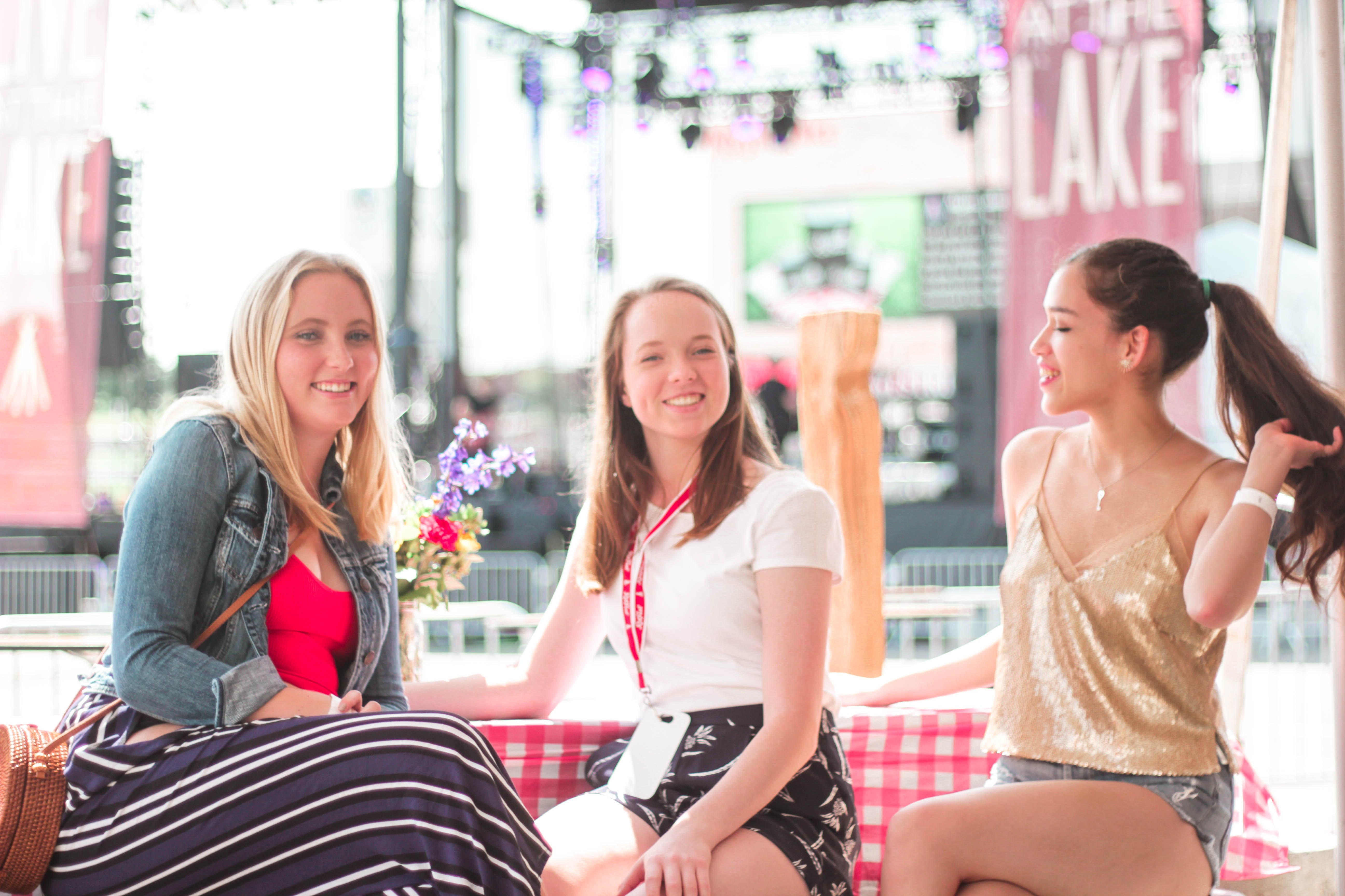 Minnesota travel blogger Eva Phan of Eva Darling at the mystic lake casino great midwest ribfest with friend in gold sequin camisole top from forever 21 f21 and citizens of humanity mid-rise denim distressed shorts
