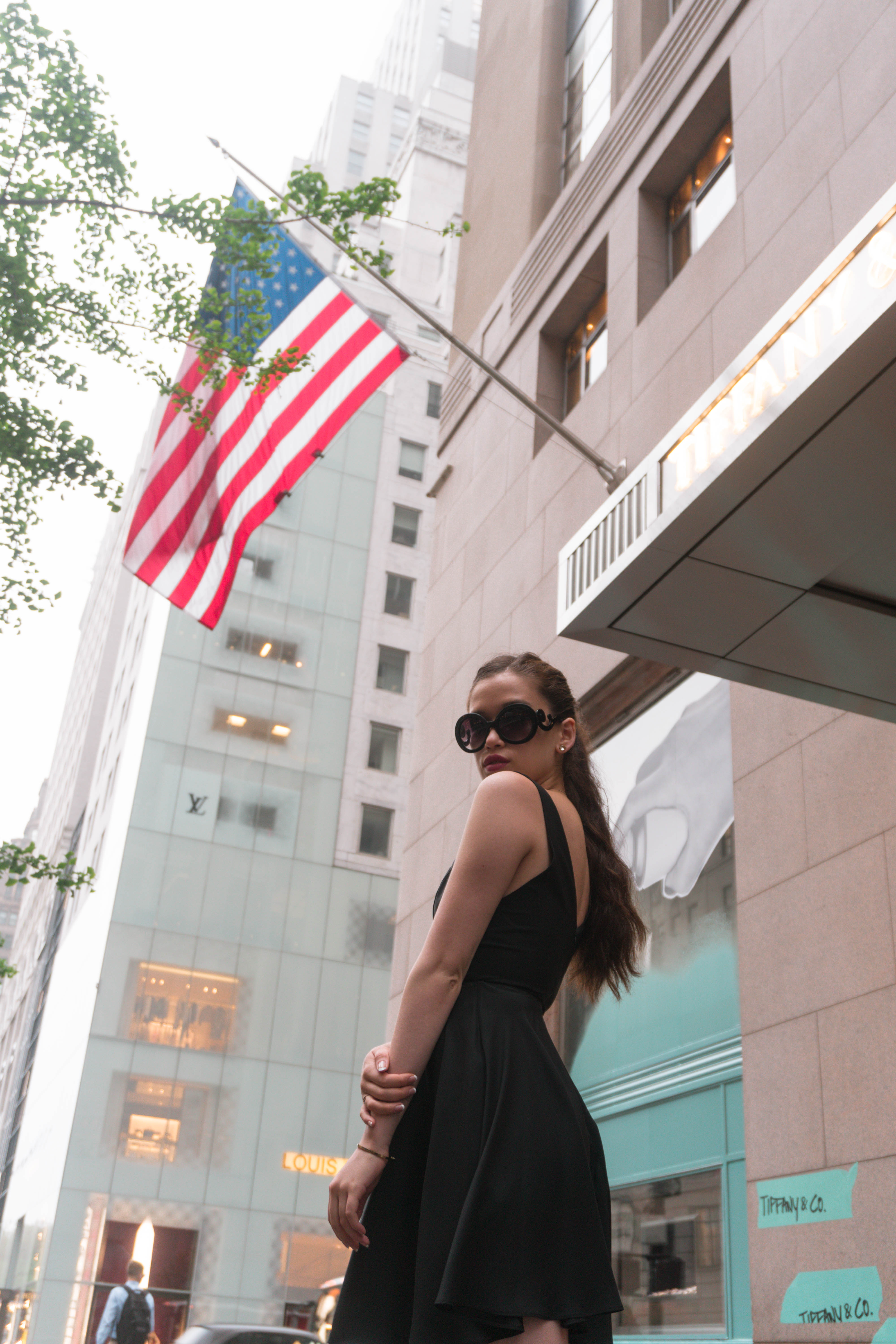 Eva Darling at the 5th ave avenue Tiffany and Co flagship store in manhattan new york NYC city in black amanda uprichard silk lbd little black dress prada baroque sunglasses american flag tiffany blue