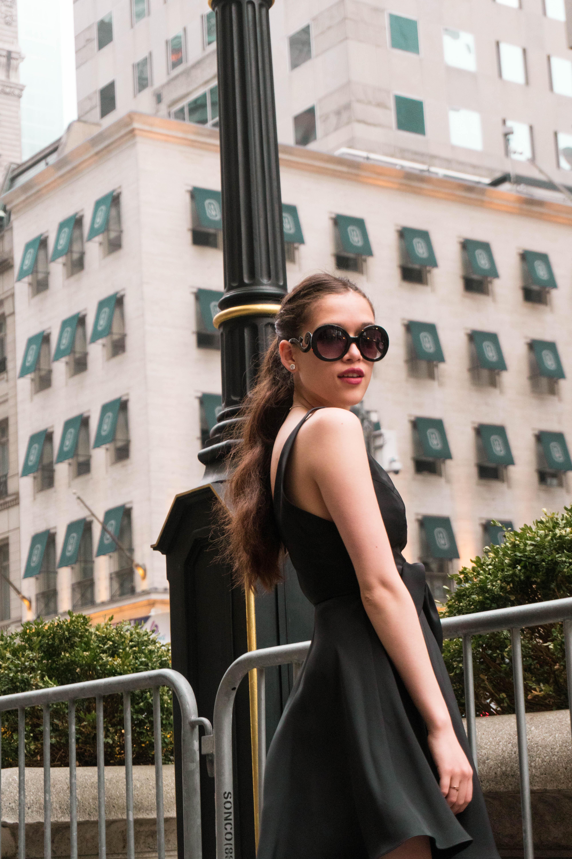 Eva Darling in little black dress silk amanda uprichard outside of Trump Tower on 5th avenue new york NYC manhattan