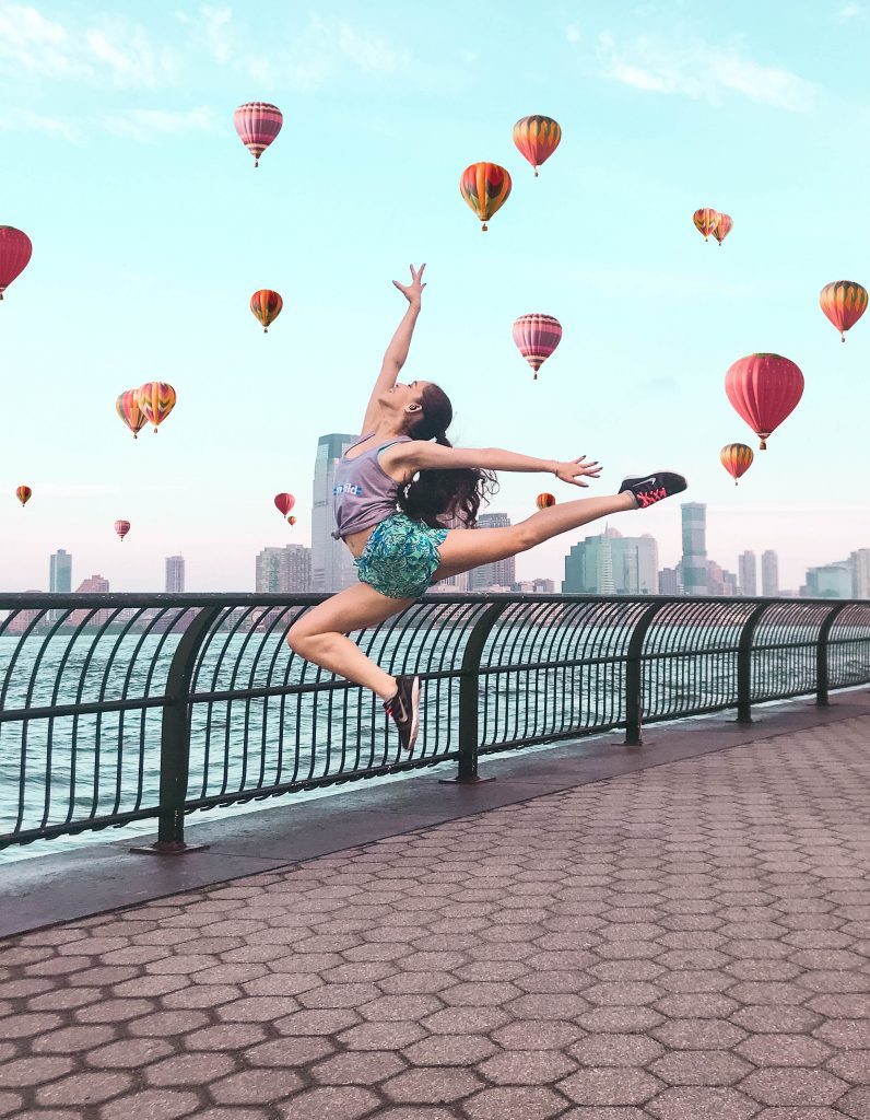 Eva Phan of Eva Darling ballet dancer contemporary jump battery park city new york city nyc hot air balloon balloons photohshop editing long brown hair ponytail curled Lilly Pulitzer run around shorts
