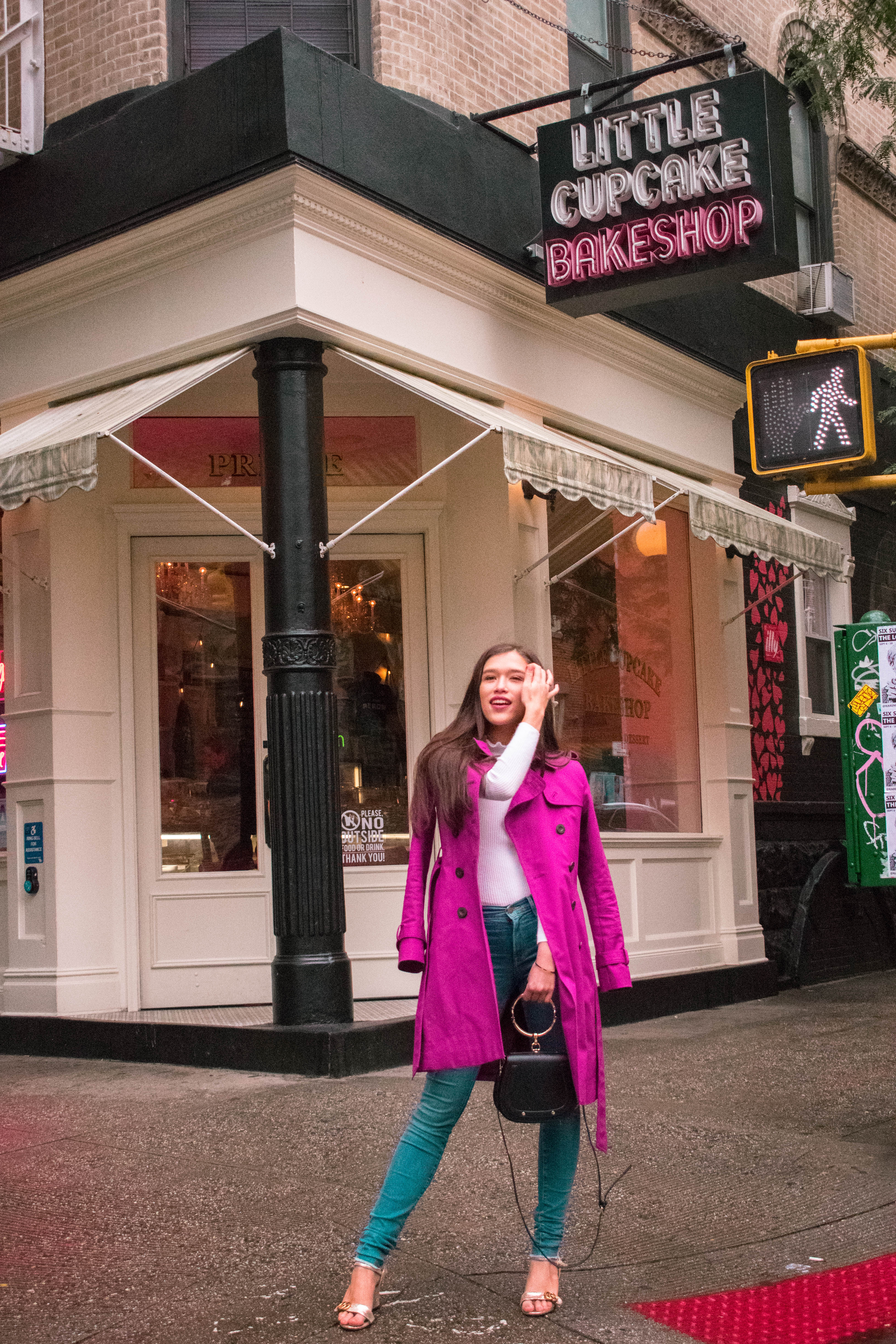 Style and travel blogger Eva Phan of Eva Darling at Little Bake Shop magenta hobbs trench coat rain jacket soho manhattan high waisted frame denim jeans white ruffle turtleneck sweater fucci gold city marmont sandal forever karlie distressed