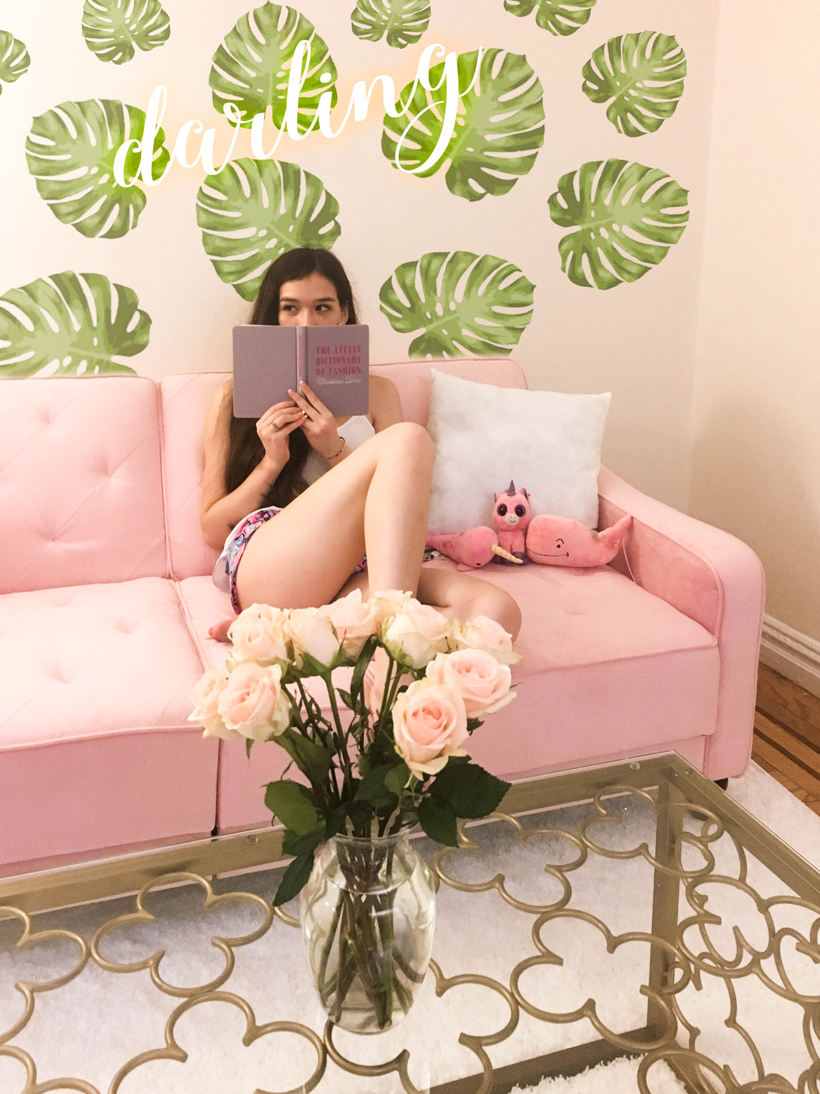Lifestyle blogger Eva Phan of Eva Darling in her NYC studio apartment pink vintage tufted futon novogratz dhp furniture glass table overstock