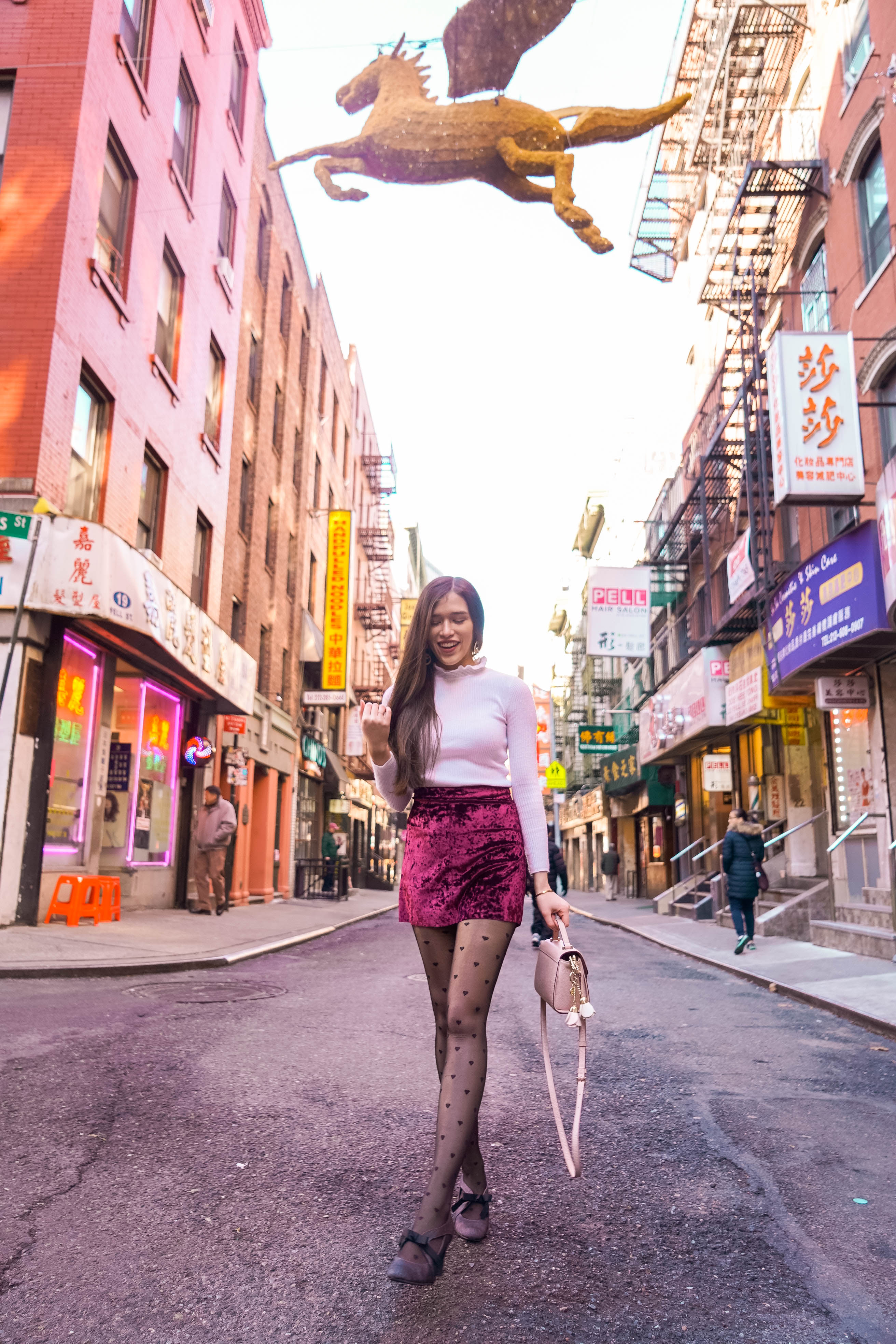 style and fashion blogger Eva Phan of Eva Darling in Chinatown NYC Manhattan wearing a white ruffle detail turtleneck sweater burgundy velvet miniskirt trendy short skirt wine merlot heart print black tights dsw ann marino pump heels kate spade mini mikayla light pink pale cobbled leather satchel holiday outfit inspiration what to wear on thanksgiving winter outfit ootd inspo teen fashion college affordable style