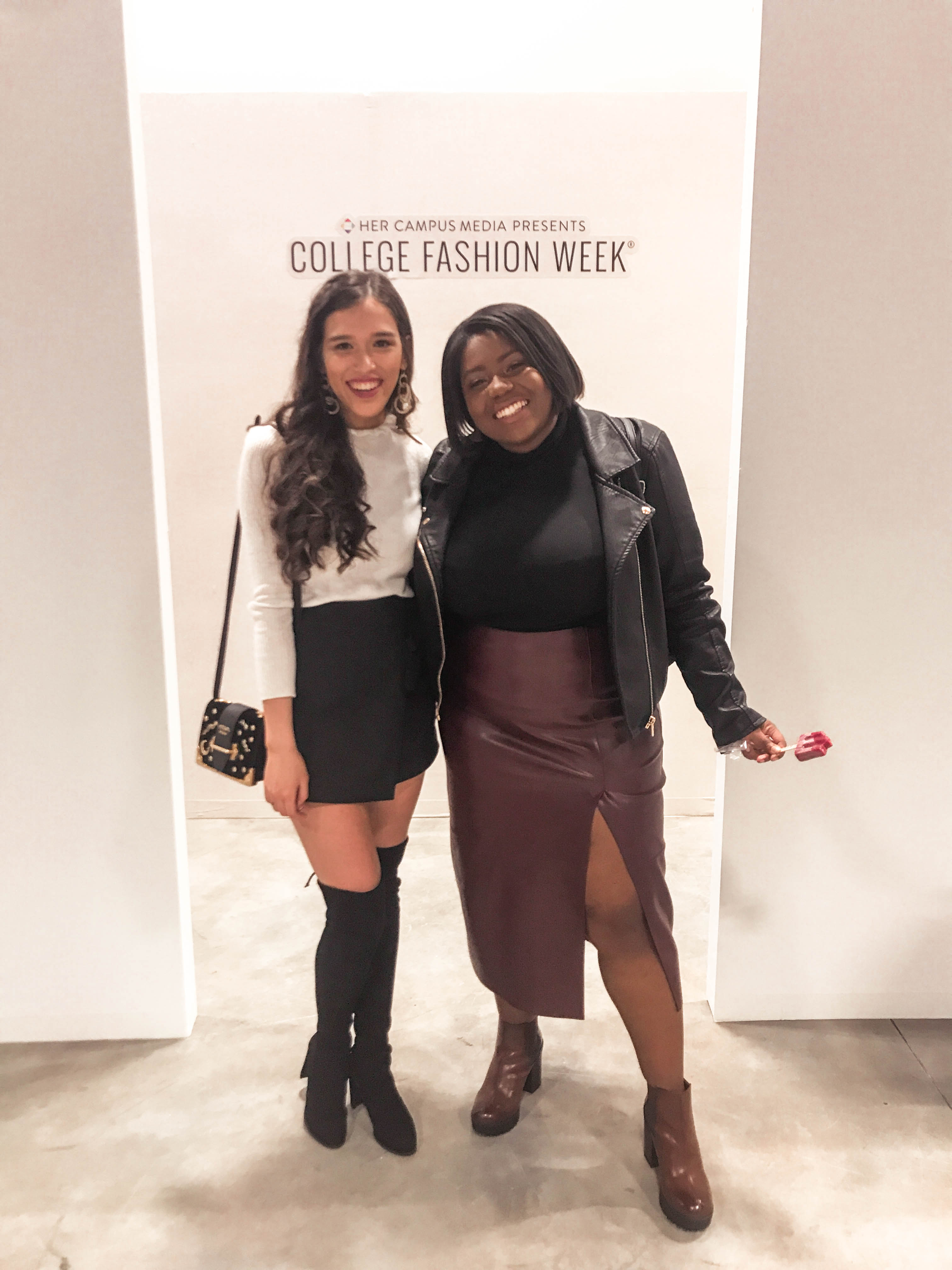 NYC style blogger event Her Campus College Fashion Week InfluenceHer Collective Eva Phan of Eva Darling Gabby Whitten of The Swirl Blog Black wrap skirt stuart weitzman black over the knee boots prada astrology cahier white primark turtleneck faux. leather midi skirt leather moto jacket
