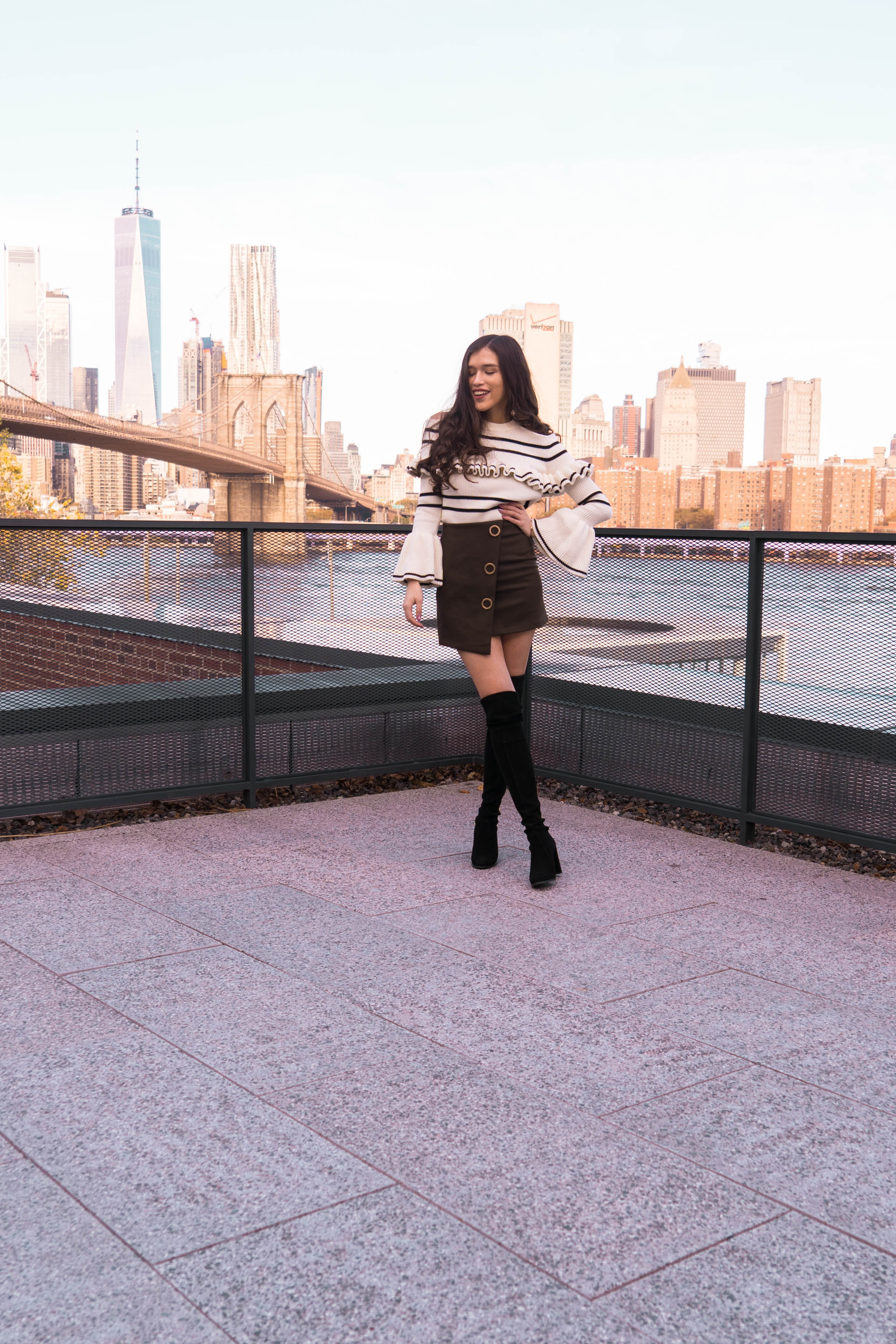 Popular NYC travel and style blogger Eva Phan of Eva Darling in DUMBO Brooklyn Manhattan skyline view roodtop World Trade Center Brooklyn Bridge self portrait bell sleeve sweater army green mini skirt black stuart weitzman hiline over the knee boots otk suede where to go in New York hidden public access rooftop free photography location trendy luxury teen ootd inspiration