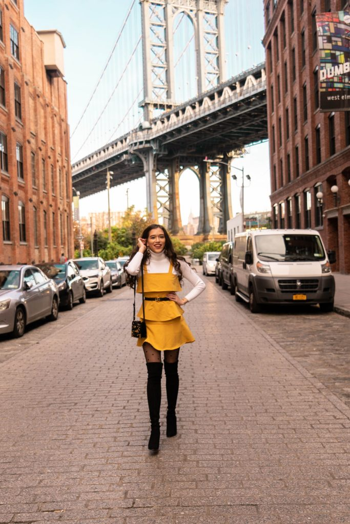NYC style and fashion blogger in DUMBO Brooklyn thin skinny 1 inch gucci belt outfit with dress yellow ruffle stuart weitzman hiline black suede over the knee otk boots ootd inspo white turtleneck sweater prada astrology cahier black velvet