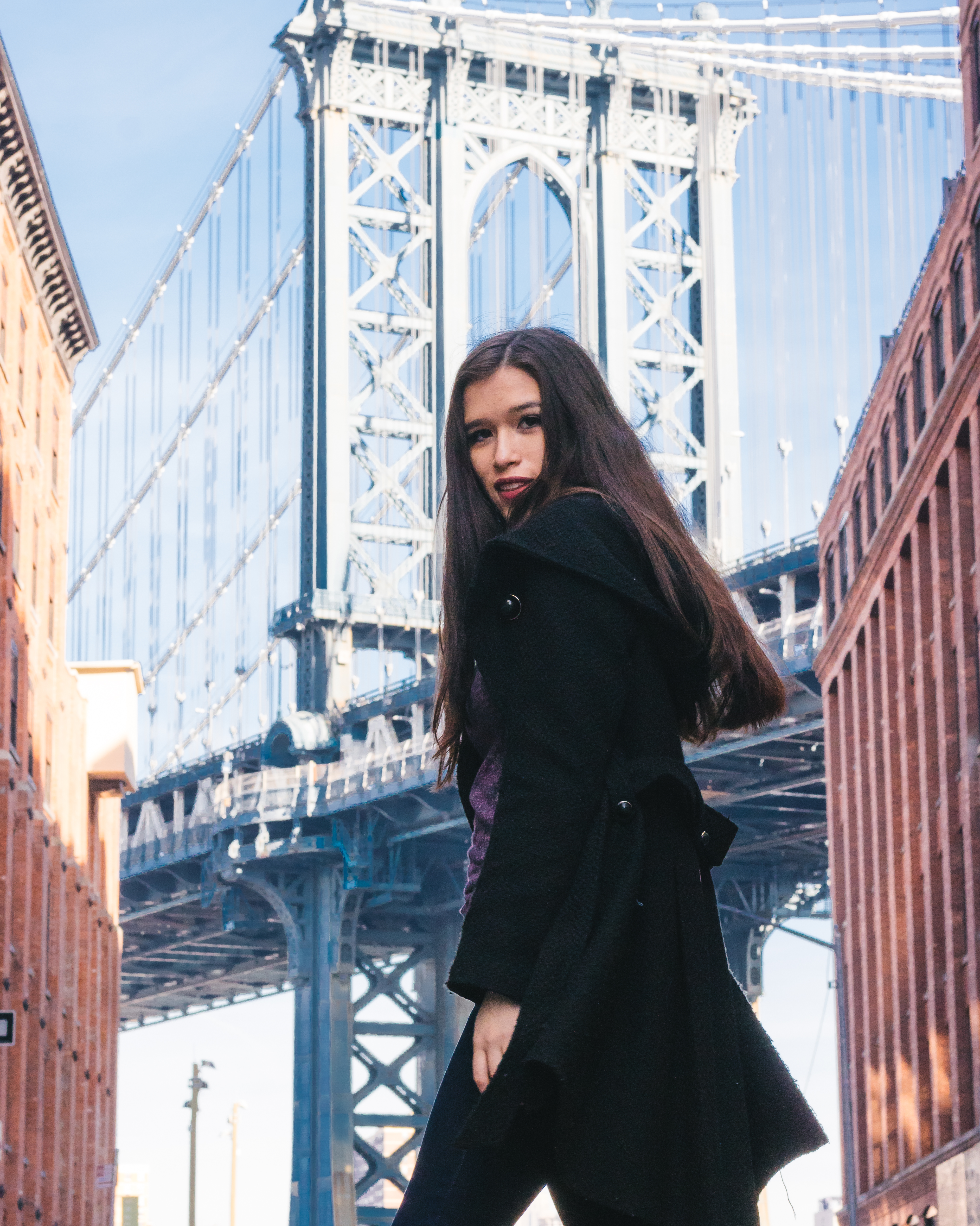 style blogger Eva Phan of Eva Darling in DUMBO Brooklyn wearing a black steve madden coat on the corner of washington st and main st