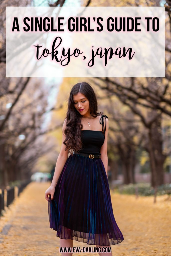 Eva Phan of Eva Darling A Solo Girl's Guide to Tokyo, Japan solo female traveler asia travel guide Icho namiki avenue gaiemmae ginkgo trees black bodycon dress boohoo tie straps with bow how to style what to wear with black gucci belt leather iridescent metallic purple blue pleated midi skirt long brown curled hair brunette modest fashion flattering college luxury style ootd inspo