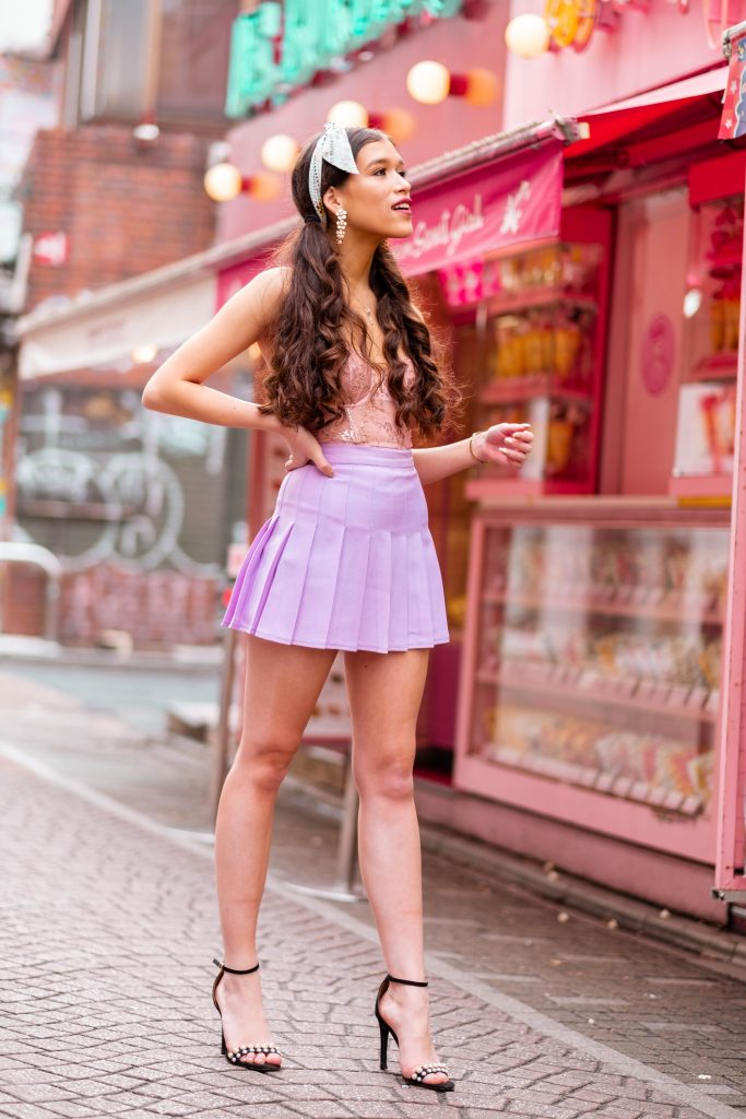 Travel and style blogger Eva Phan of Eva Darling outside of Santa Monica Crepes kawaii dessert Takeshita Street harajuku shibuya tokyo japan kawaii fashion american apparel lilac tennis skirt victoria's secret unlined dream angels scalloped lace bustier demure pink rose gold shine dior mitzah tarot twilly boohoo pearl strappy black stiletto what to wear teen girl fashion how to wear a hair scarf