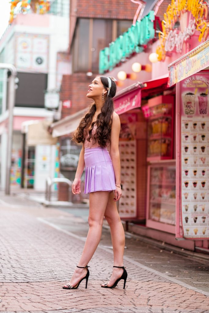 Travel and style blogger Eva Phan of Eva Darling outside of Santa Monica Crepes kawaii dessert Takeshita Street harajuku shibuya tokyo japan kawaii fashion american apparel lilac tennis skirt victoria's secret unlined dream angels scalloped lace bustier demure pink rose gold shine dior mitzah tarot twilly boohoo pearl strappy black stiletto what to wear teen girl fashion how to wear a hair scarf girly feminine fashion
