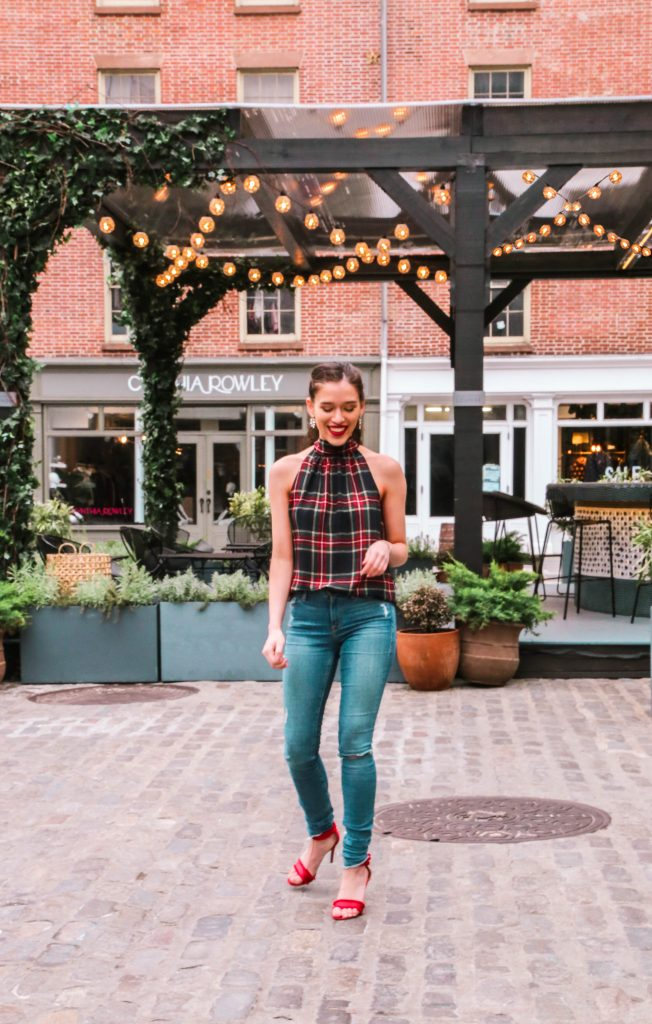 NYC style blogger Eva Phan of Eva Darling wearing an affordable inexpensive trendy plaid tie back halter top J.Crew Factory Christmas holiday Frame denim jeans and red stiletto shoes from Who What Wear at Target long brown hair brunette high ponytail curled