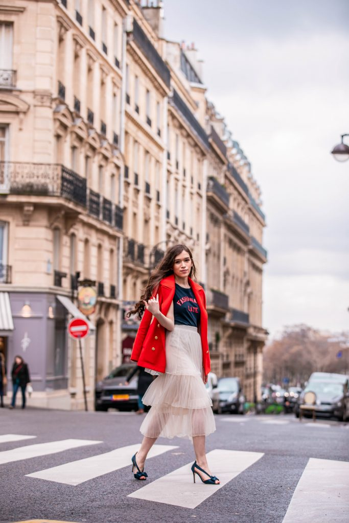 Eva Phan of Eva Darling Paris France street style paris fashion week pfw how to style a tulle skirt affordable midi length layered cream tulle skirt orange double breasted wool pea coat navy silk bow nina shoes DSW j crew chic women's style trendy casual affordable OOTD idea what to wear in france parisian style