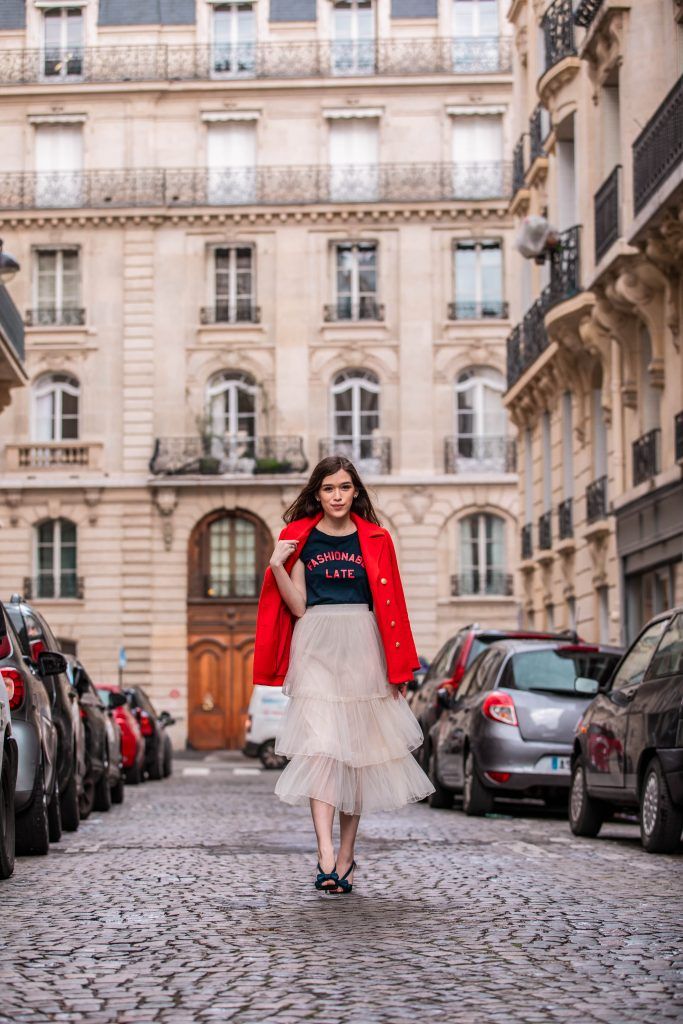 Eva Phan of Eva Darling Paris France street style paris fashion week pfw how to style a tulle skirt affordable midi length layered cream tulle skirt orange double breasted wool pea coat navy silk bow nina shoes DSW j crew chic women's style trendy casual affordable OOTD idea what to wear in france for fashion week style blogger fashion advice