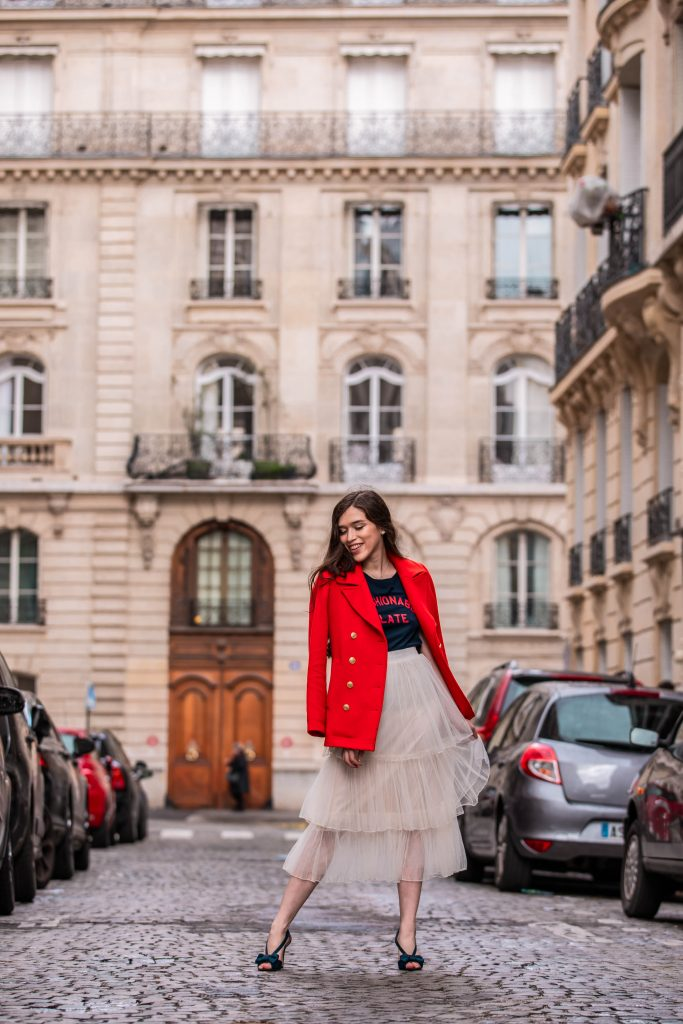 Eva Phan of Eva Darling Paris France street style paris fashion week pfw how to style a tulle skirt affordable midi length layered cream tulle skirt orange double breasted wool pea coat navy silk bow nina shoes DSW j crew chic women's style trendy casual affordable OOTD idea what to wear in france for fashion week style blogger fashion advice feminine fashion outfit idea modest women's style