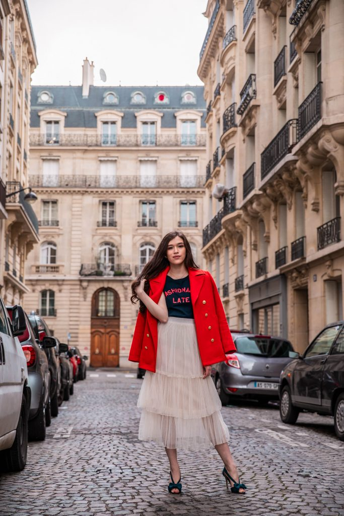 Eva Phan of Eva Darling Paris France street style paris fashion week pfw how to style a tulle skirt affordable midi length layered cream tulle skirt orange double breasted wool pea coat navy silk bow nina shoes DSW j crew chic women's style trendy casual affordable OOTD idea what to wear in france for fashion week style blogger fashion advice feminine fashion outfit idea modest women's style inexpensive cute clothing
