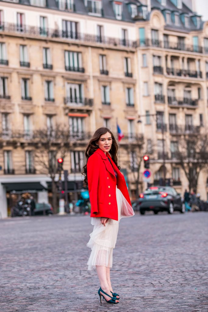 Eva Phan of Eva Darling Trocadéro Paris France street style paris fashion week pfw how to style a tulle skirt affordable midi length layered cream tulle skirt orange double breasted wool pea coat navy silk bow nina shoes