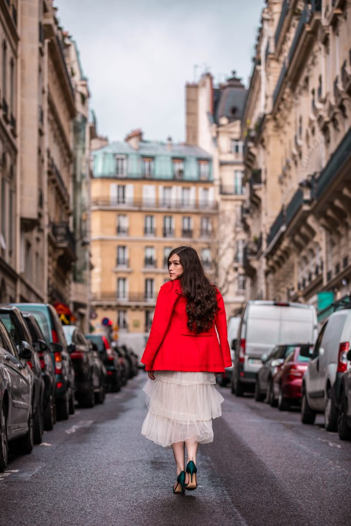 Eva Phan of Eva Darling Paris France street style paris fashion week pfw how to style a tulle skirt affordable midi length layered cream tulle skirt orange double breasted wool pea coat navy silk bow nina shoes DSW j crew
