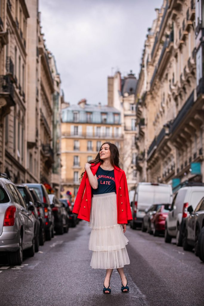 Eva Phan of Eva Darling Paris France street style paris fashion week pfw how to style a tulle skirt affordable midi length layered cream tulle skirt orange double breasted wool pea coat navy silk bow nina shoes DSW j crew chic women's style