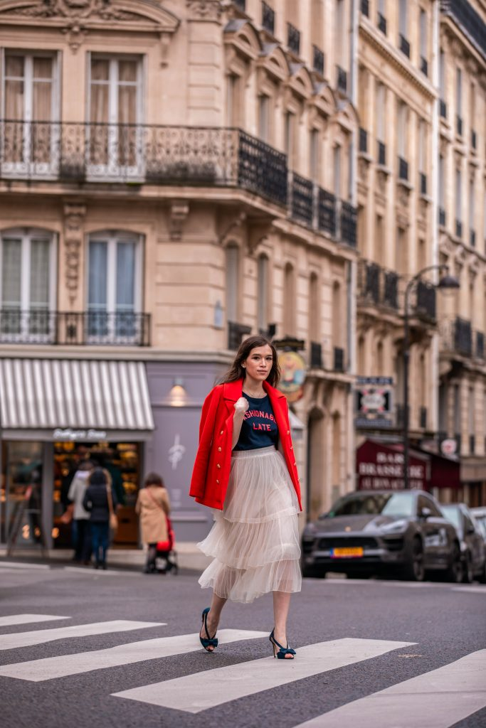 Eva Phan of Eva Darling Paris France street style paris fashion week pfw how to style a tulle skirt affordable midi length layered cream tulle skirt orange double breasted wool pea coat navy silk bow nina shoes DSW j crew chic women's style trendy casual affordable OOTD idea