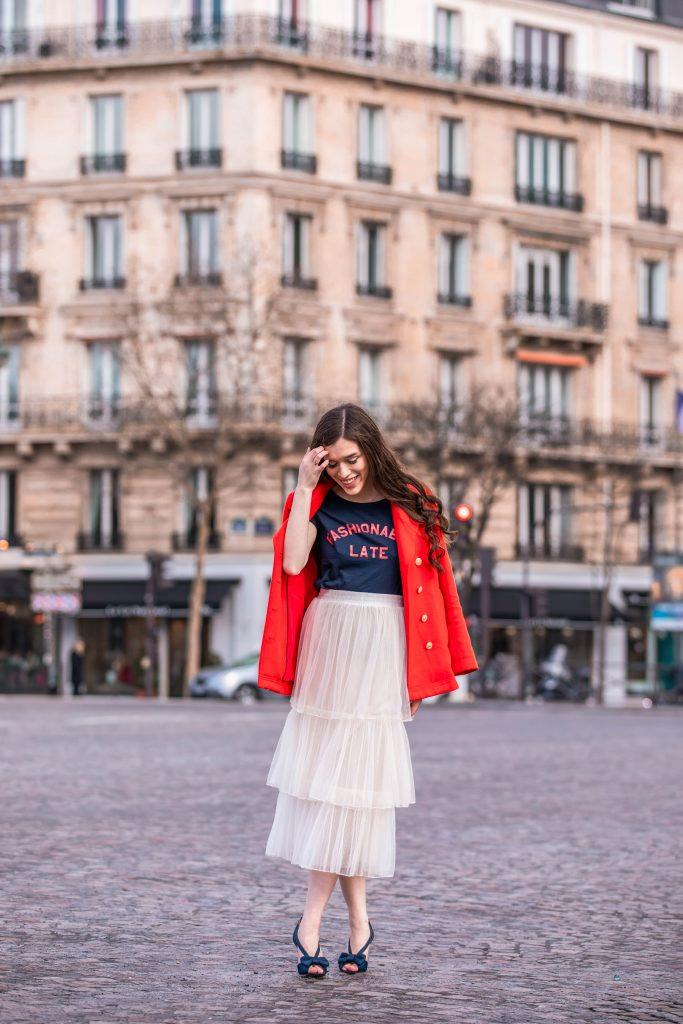 Eva Phan of Eva Darling Paris France street style paris fashion week pfw how to style a tulle skirt affordable midi length layered cream tulle skirt orange double breasted wool pea coat navy silk bow nina shoes DSW j crew chic women's style trendy casual affordable OOTD idea what to wear in france for fashion week style blogger fashion advice feminine fashion outfit idea modest women's style inexpensive cute clothing trocadero square