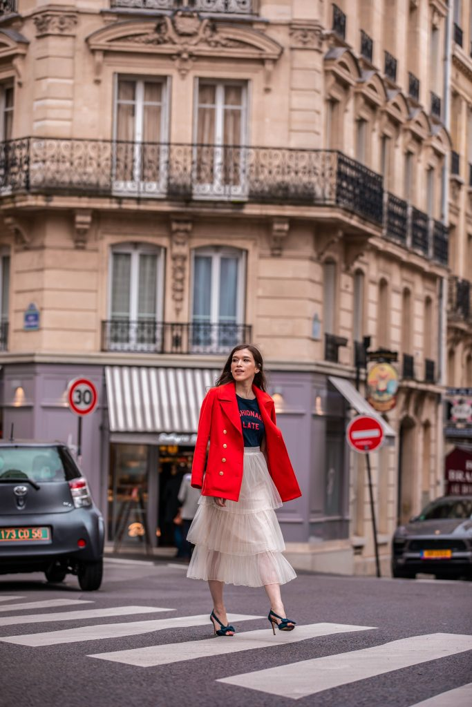 Eva Phan of Eva Darling Paris France street style paris fashion week pfw how to style a tulle skirt affordable midi length layered cream tulle skirt orange double breasted wool pea coat navy silk bow nina shoes DSW j crew chic women's style trendy casual affordable OOTD idea what to wear in france