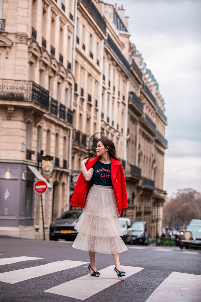 Eva Phan of Eva Darling Paris France street style paris fashion week pfw how to style a tulle skirt affordable midi length layered cream tulle skirt orange double breasted wool pea coat navy silk bow nina shoes DSW j crew chic women's style trendy casual affordable OOTD idea what to wear in france for fashion week