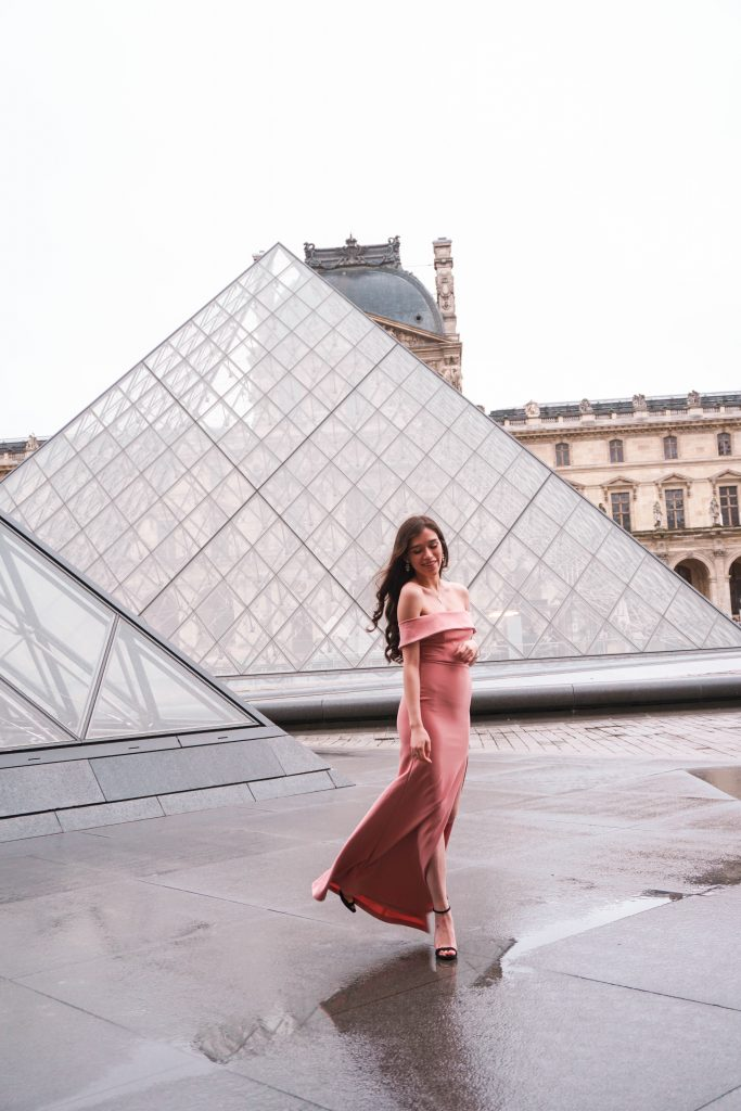 Eva Phan of Eva Darling Louvre Museum Musée du Louvre glass pyramids Paris France Lulu's Mauve Aveline Gown Loveliness black suede stiletto heel Paris photoshoot photo shoot location idea feminine style