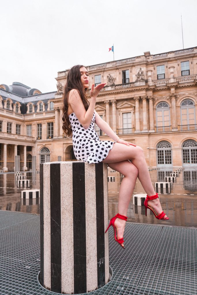 Eva Phan Eva Darling Palais Royal Revolve high commission About Us Karla Polka Dot Dress in Black & White Instagram photoshoot location Paris France instagrammable red stiletto heel Who What Wear Collection Target cute feminine style outfit girl blowing kiss