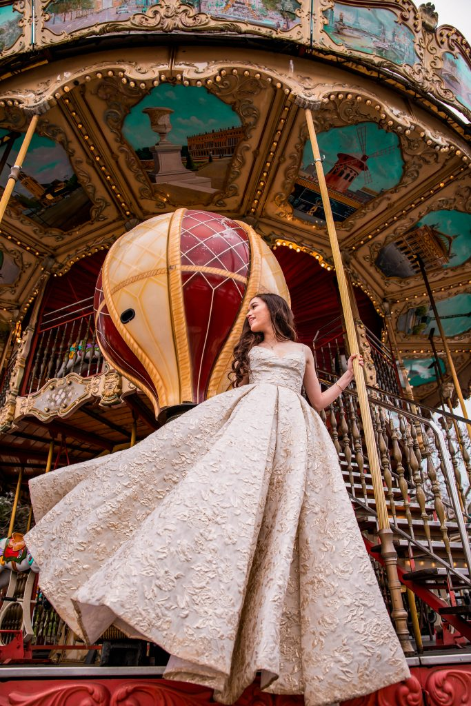 Eva Phan of Eva Darling wearing a Tarik Edix Ballgown at the eiffel tower carousel carrousel de la tour eiffel in place du trocadeo paris france paris photo inspiration photoshoot idea feminine style whimsical travel luxury fashion outfit prom dress idea