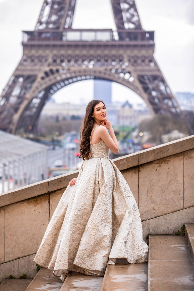 Eva Phan of Eva Darling Place du Trocadero Paris France luxury ballgown Tarik Ediz Eiffel Tower wedding photo inspiration where to see the eiffel tower 16e arrondissement feminine fashion princess prom style dress inspiration brunette long brown hair curled paris photo idea