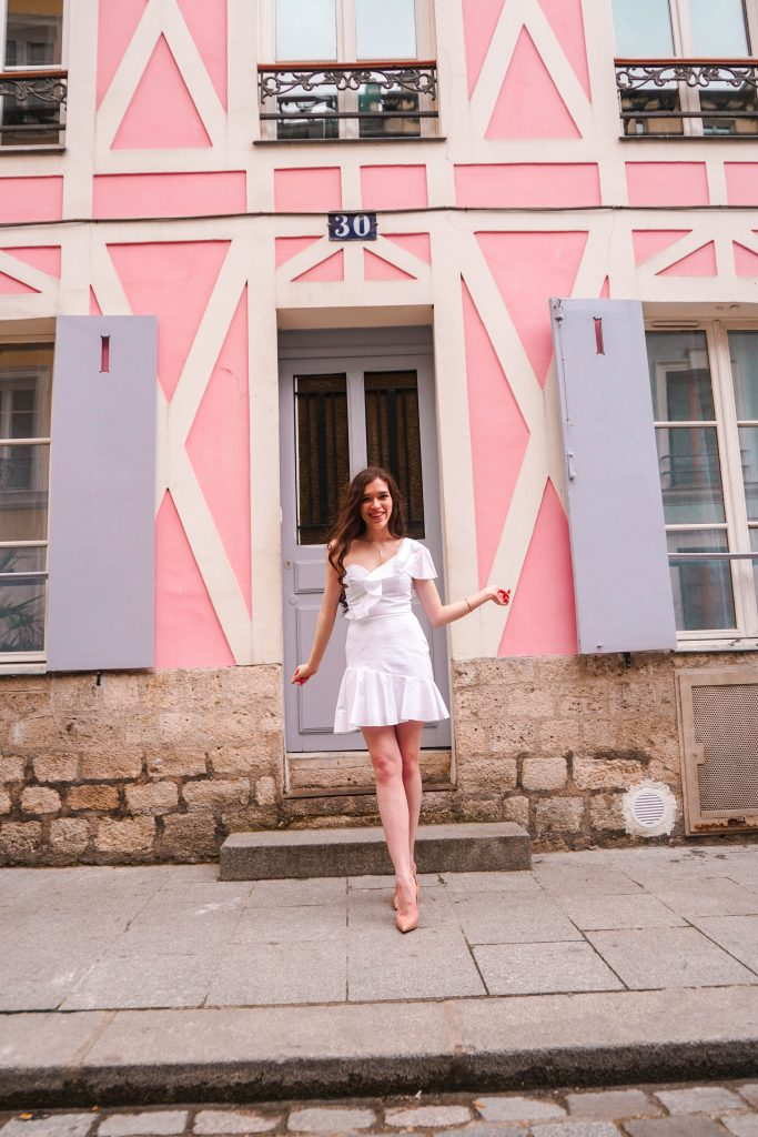 style blogger Eva Phan of Eva Darling on rue cremieux in paris france most instagram worthy instagrammable road in Paris best spot for a photo in france white amanda uprichard vanderbilt dress christian louboutin hot chick pumps in nude cute women's outfit idea parisian style