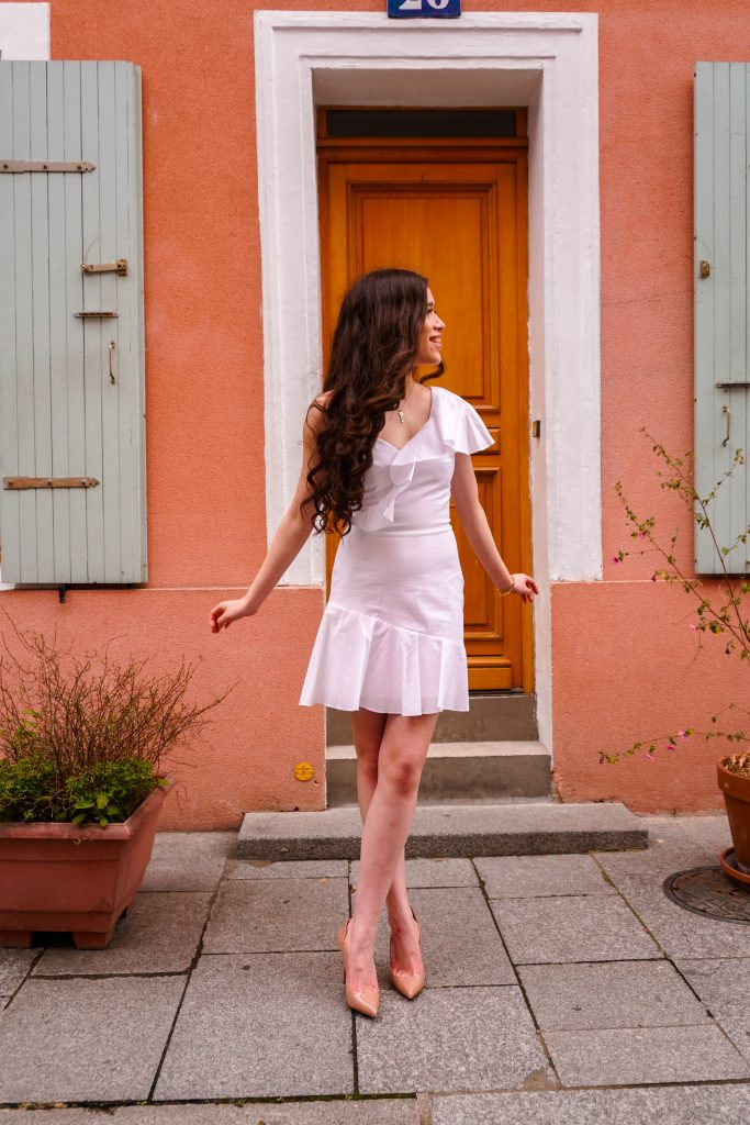 style blogger Eva Phan of Eva Darling on rue cremieux in paris france most instagram worthy instagrammable road in Paris best spot for a photo in france white amanda uprichard vanderbilt dress christian louboutin hot chick pumps in nude orange house