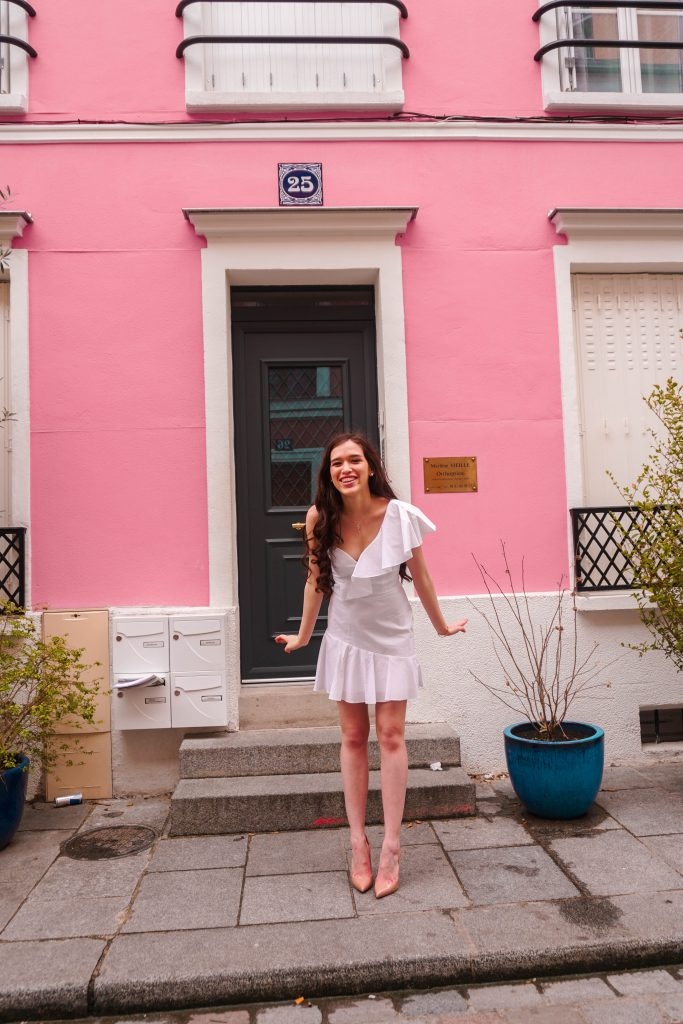 style blogger Eva Phan of Eva Darling on rue cremieux in paris france most instagram worthy instagrammable road in Paris best spot for a photo in france white amanda uprichard vanderbilt dress christian louboutin hot chick pumps in nude pink house photoshoot idea