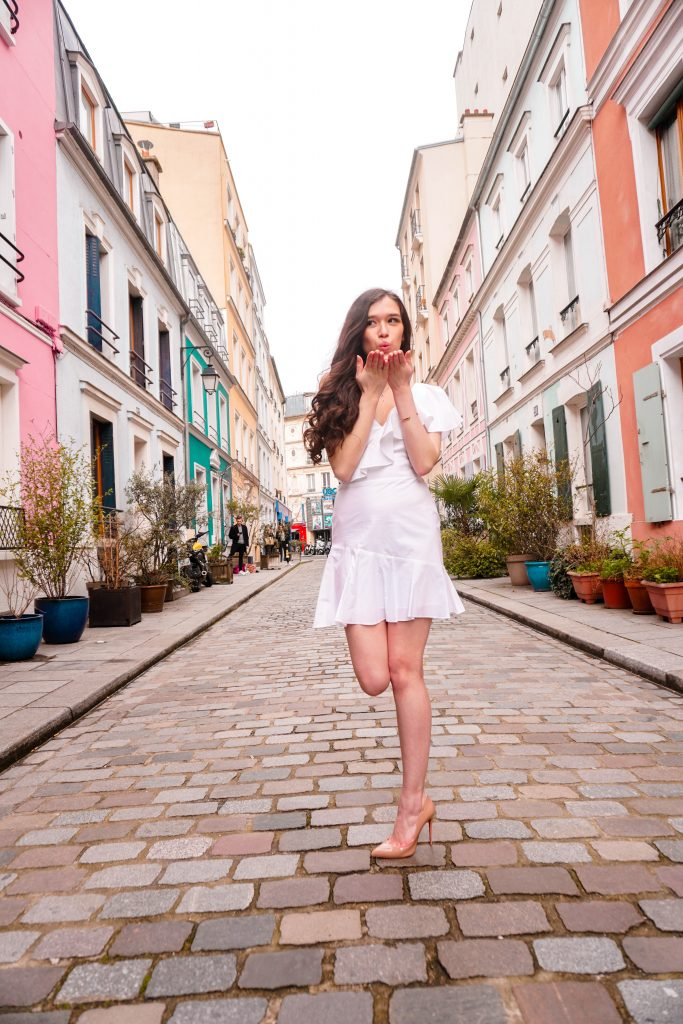 Eva Phan Eva Darling Rue Cremieux Paris France most instagram worthy road bright colored houses pastel pink instagrammable spot white amanda uprichard vanderbilt dress christian loubouting hot chick nude shoes feminine women's fashion long brown curled hair where to go in paris