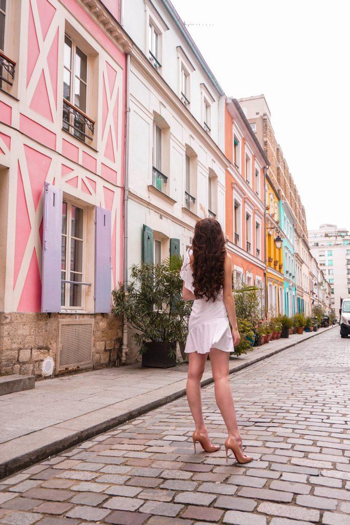 Eva Phan Eva Darling Rue Cremieux Paris France most instagram worthy road bright colored houses pastel pink instagrammable spot white amanda uprichard vanderbilt dress christian loubouting hot chick nude shoes