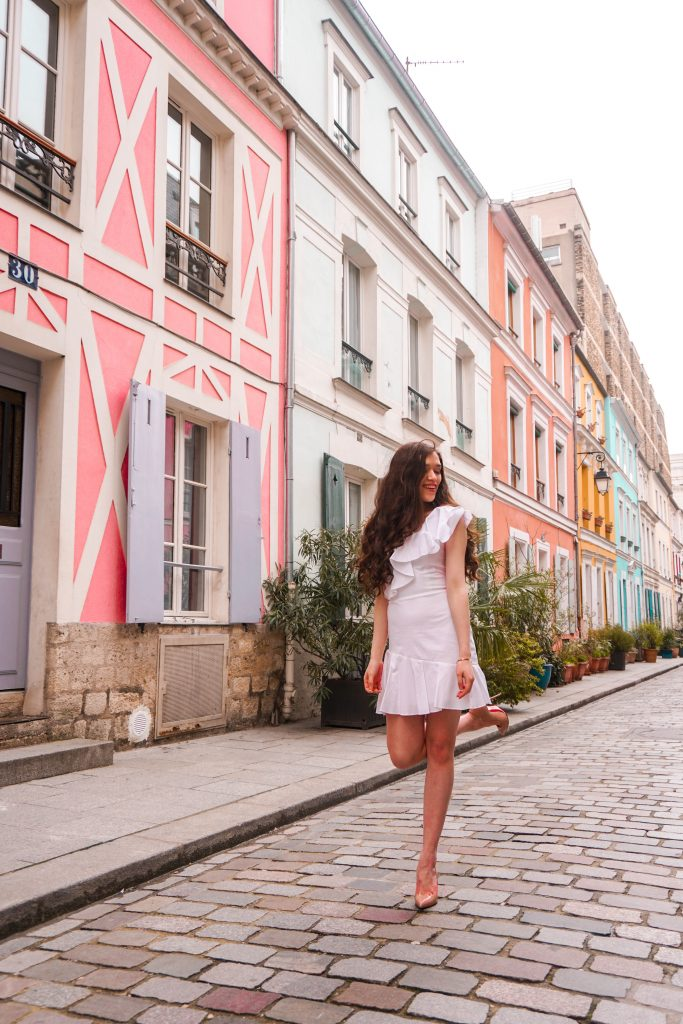 Eva Phan Eva Darling Rue Cremieux Paris France most instagram worthy road bright colored houses pastel pink instagrammable spot white amanda uprichard vanderbilt dress christian loubouting hot chick nude shoes feminine women's fashion