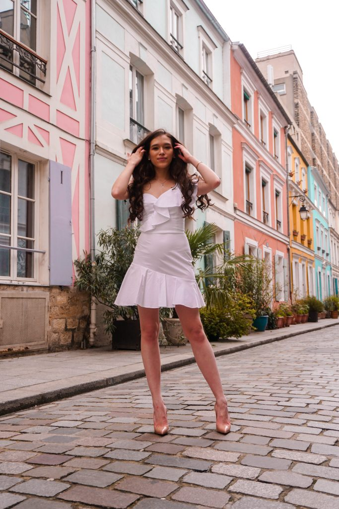 Eva Phan Eva Darling Rue Cremieux Paris France most instagram worthy road bright colored houses pastel pink instagrammable spot white amanda uprichard vanderbilt dress christian loubouting hot chick nude shoes feminine women's fashion long brown curled hair