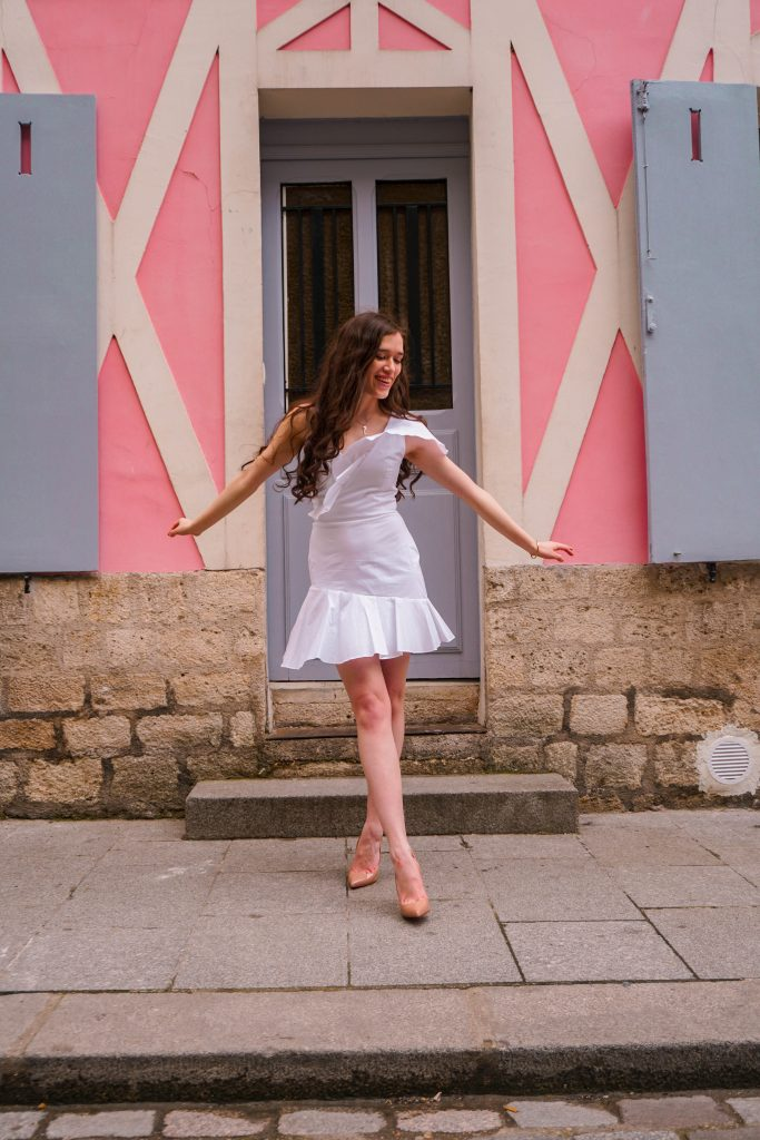 style blogger Eva Phan of Eva Darling on rue cremieux in paris france most instagram worthy instagrammable road in Paris best spot for a photo in france white amanda uprichard vanderbilt dress