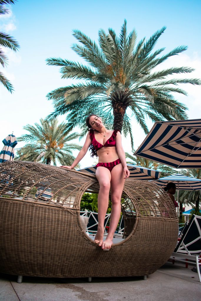 Travel blogger Eva Darling at the Hilton West Palm Beach pool velvet ruffle bikini inexpensive swimwear vacation florida