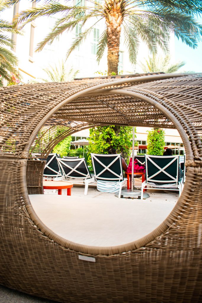 wicker daybed poolside at the Hilton West Palm Beach