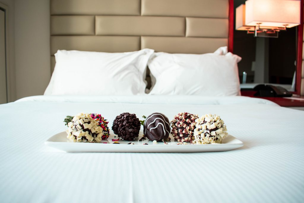 Luxury hotel chocolate dipped strawberries at the Hilton West Palm Beach's queen junior suite