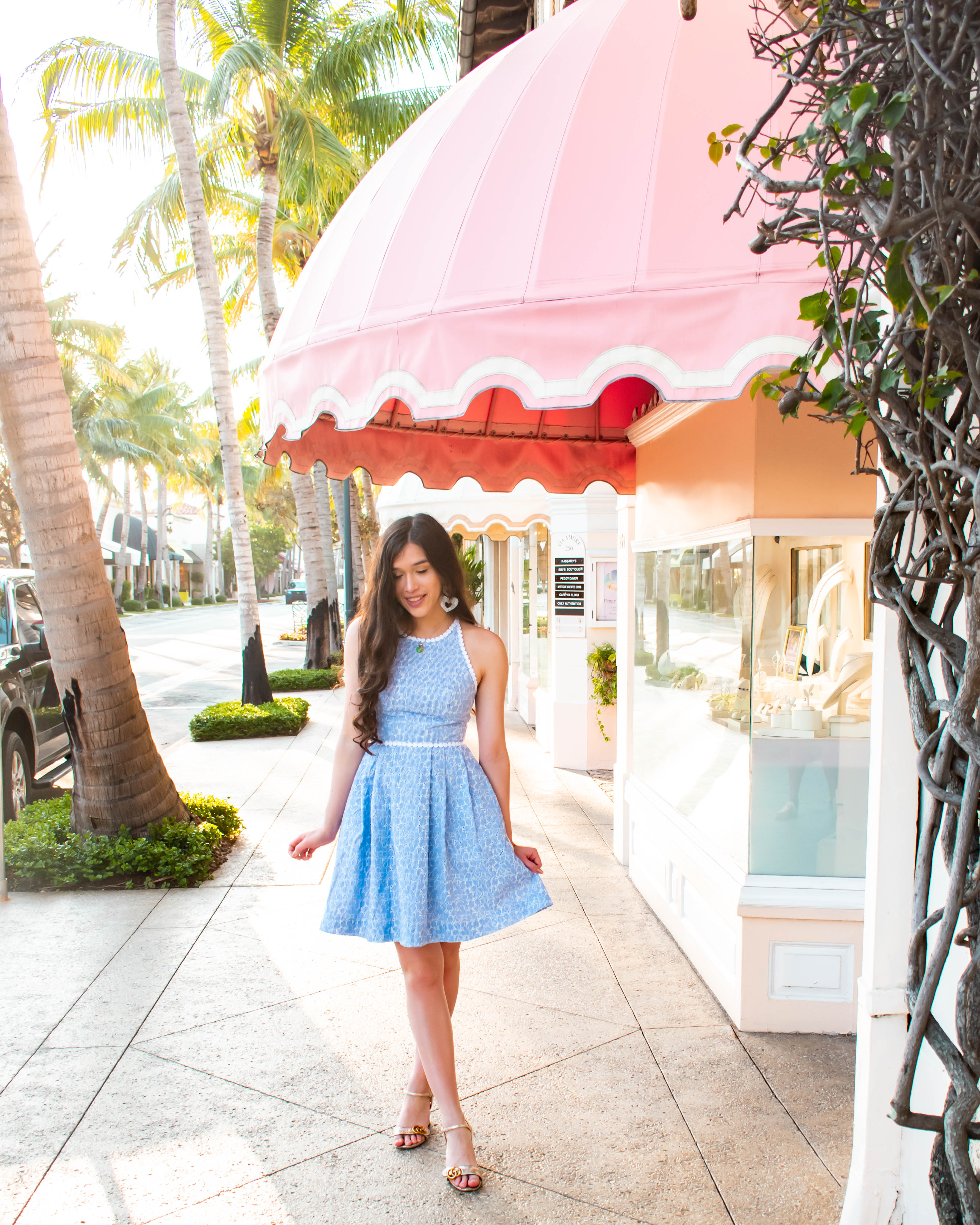 Style and travel blogger Eva Darling wearing a Lilly Pulitzer Tori Dress striped lace fit and flare flattering summer sundress on instagrammable Worth Ave in Palm Beach preppy women's clothing